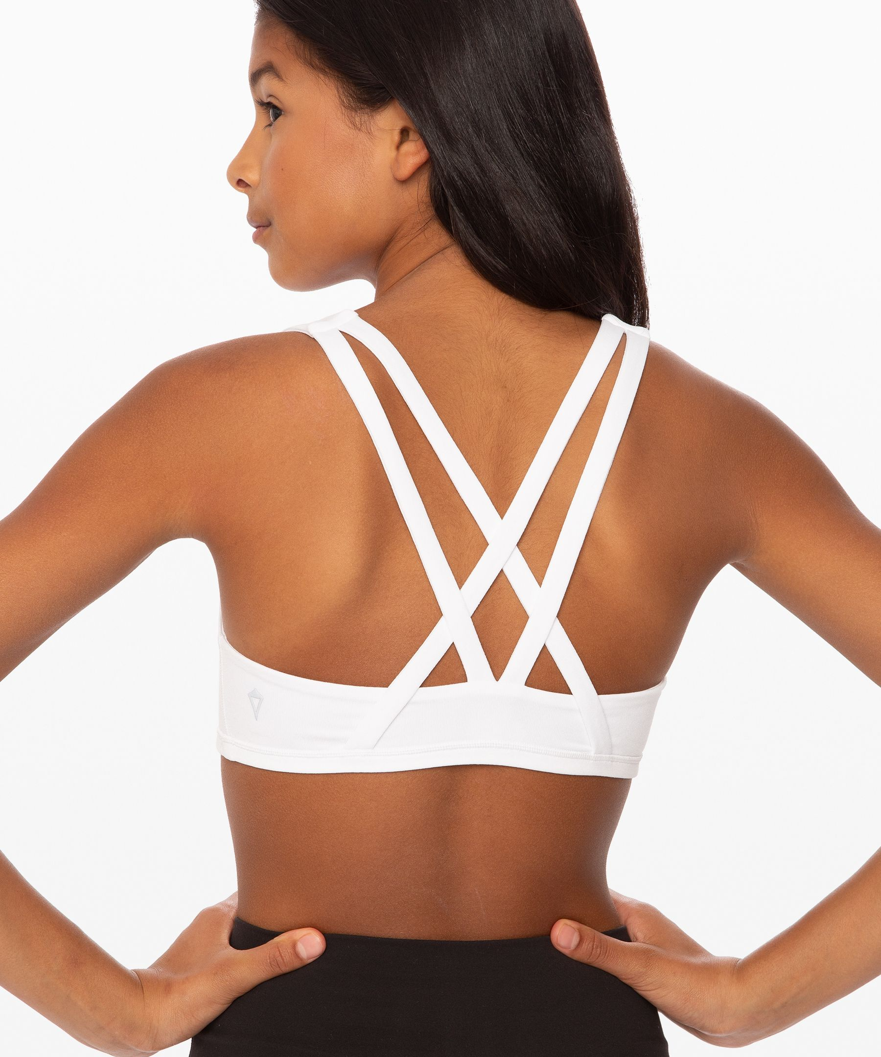 Minimize distractions and  conquer your goals in this  strappy reversible bra.