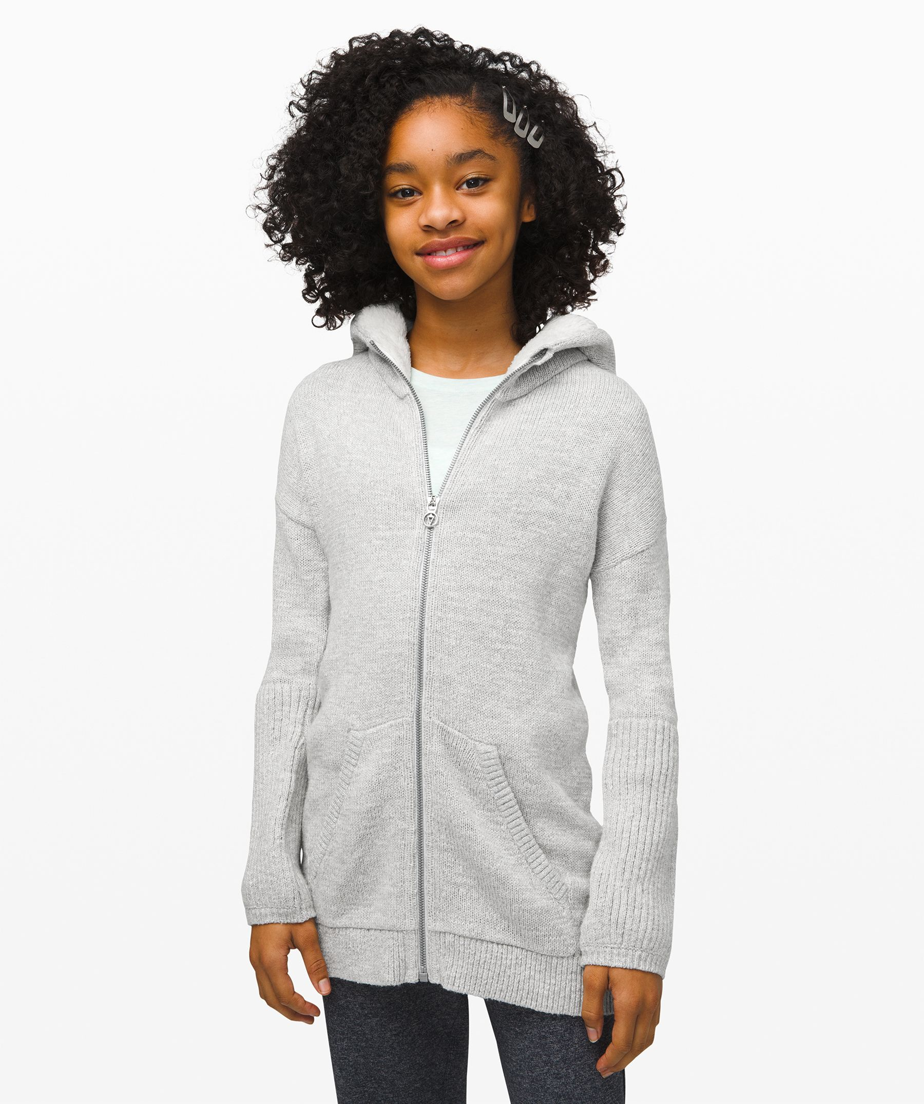 To class, practice, and  beyond. This knit jacket will  keep her warm, wherever she  goes.