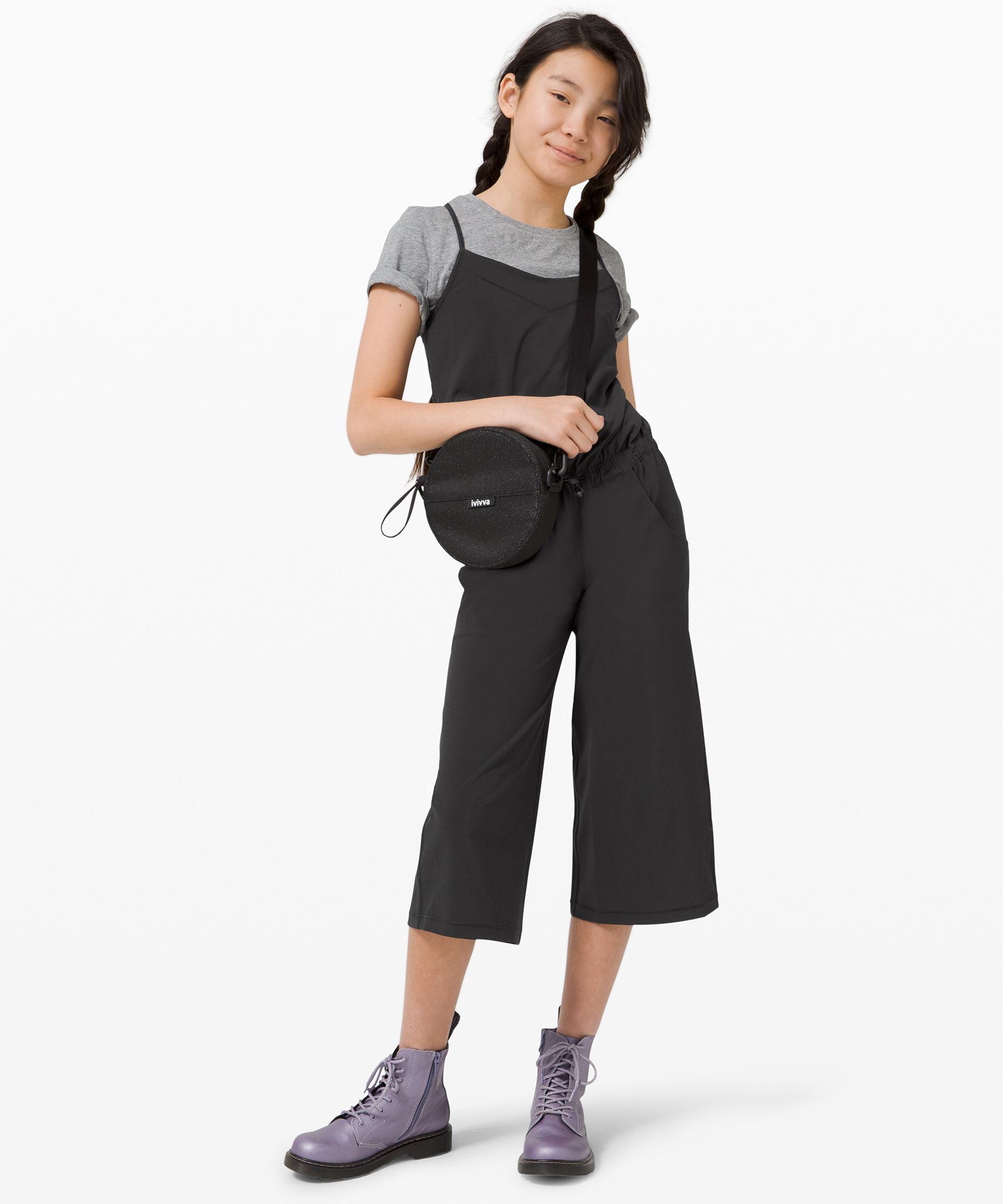 Made to layer effortlessly  over a bodysuit or swimsuit,  this cute lightweight jumpsuit  is an easy layer before and  after dance class or swim  lessons.