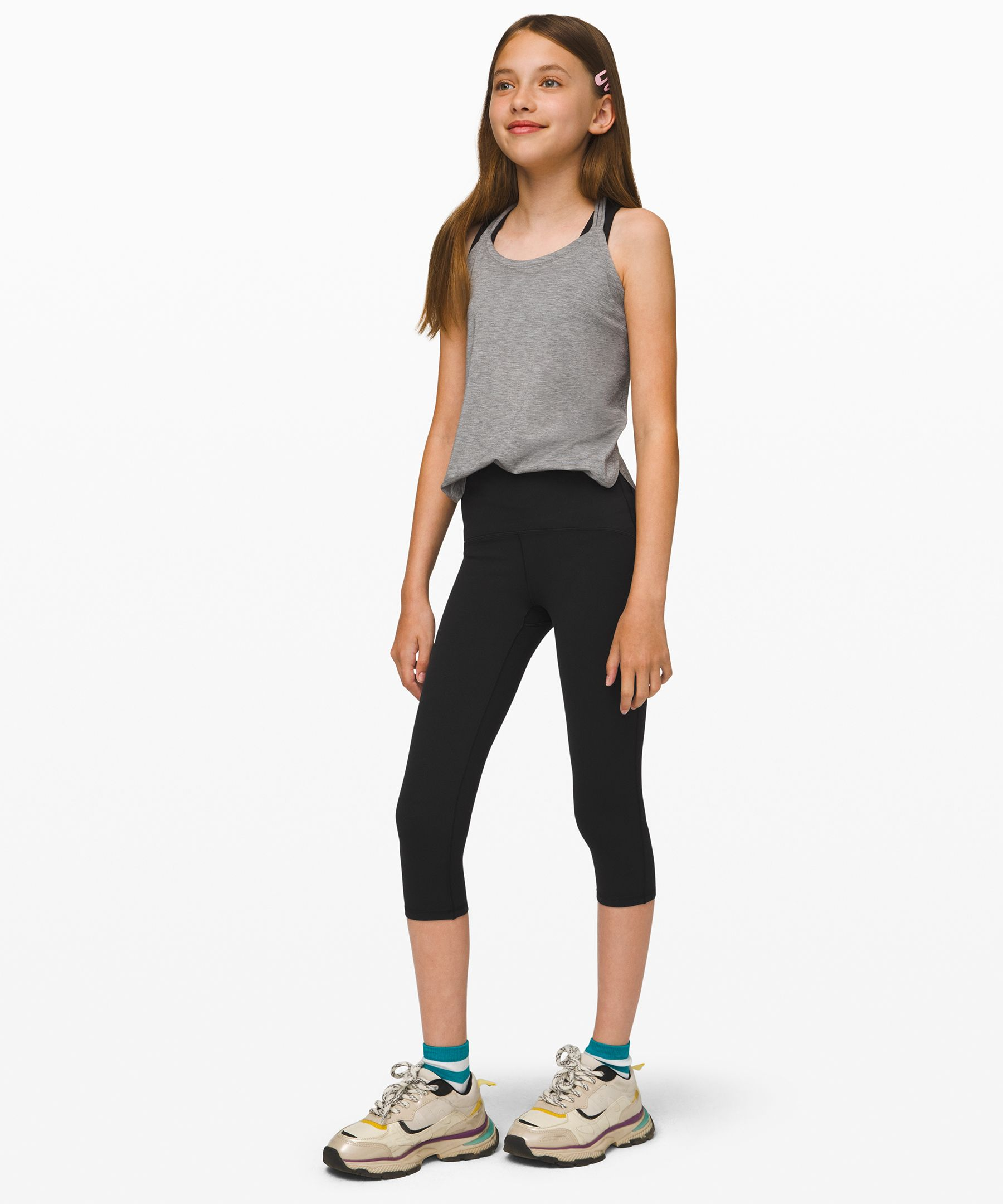 These high-rise crops are  soft, smooth, and  distraction-free: perfect for  practicing those pivots,  plies, and pirouettes. Wear  them high for coverage or  folded over to cool down.