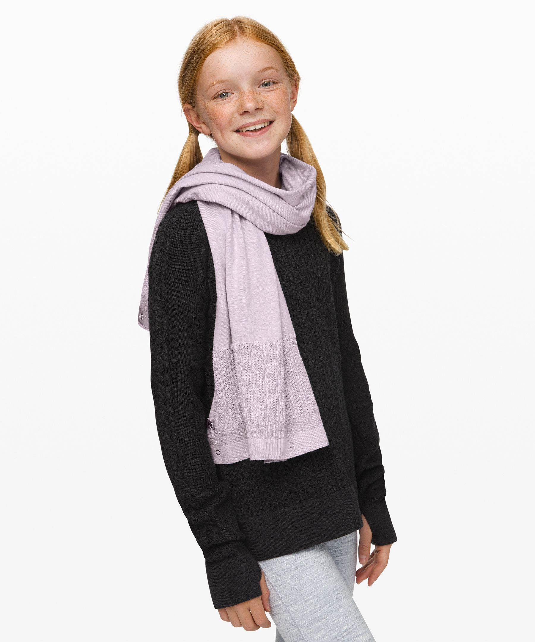 She can double-wrap this scarf  to bundle up on chilly days or  unsnap it to style it in her  own unique way.