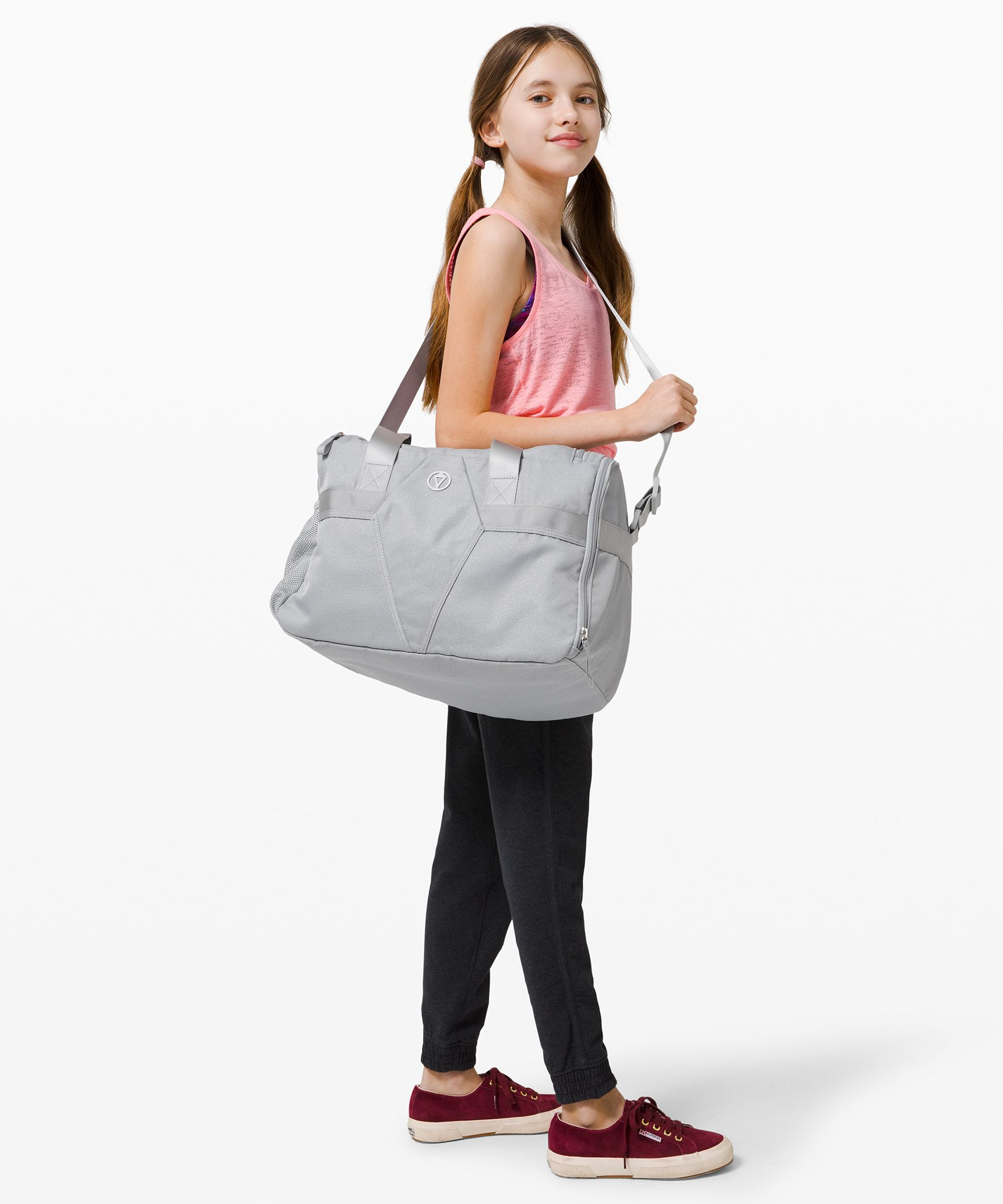 This spacious duffel was  designed with multiple pockets  to separate her gear and keep  her organized.