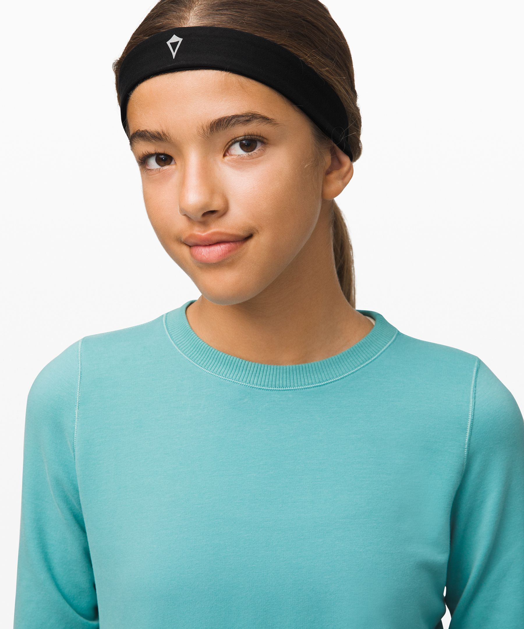 Keep your focus on your moves,  not your mane in this headband  with a silicone gripper.