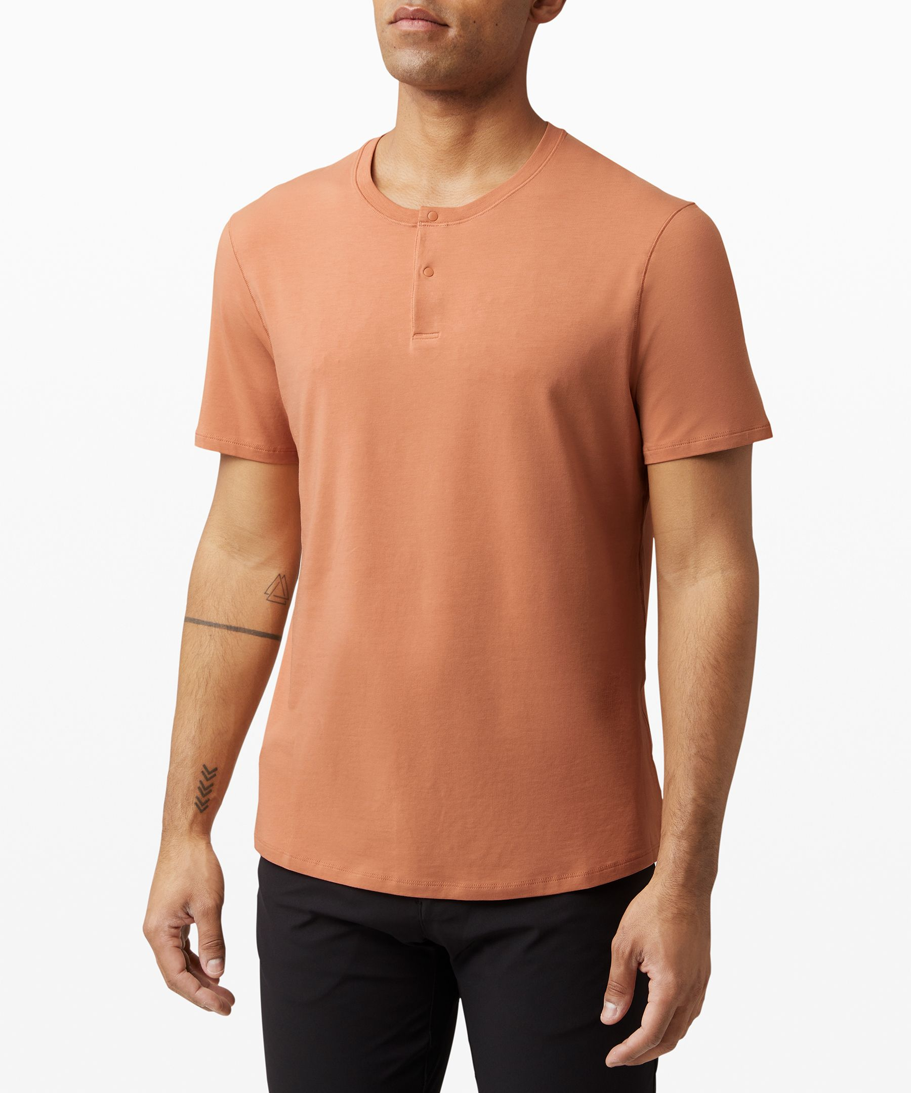 We made this versatile,  short-sleeve henley with  technical fabric that feels  natural, so you can move  through your day in comfort.