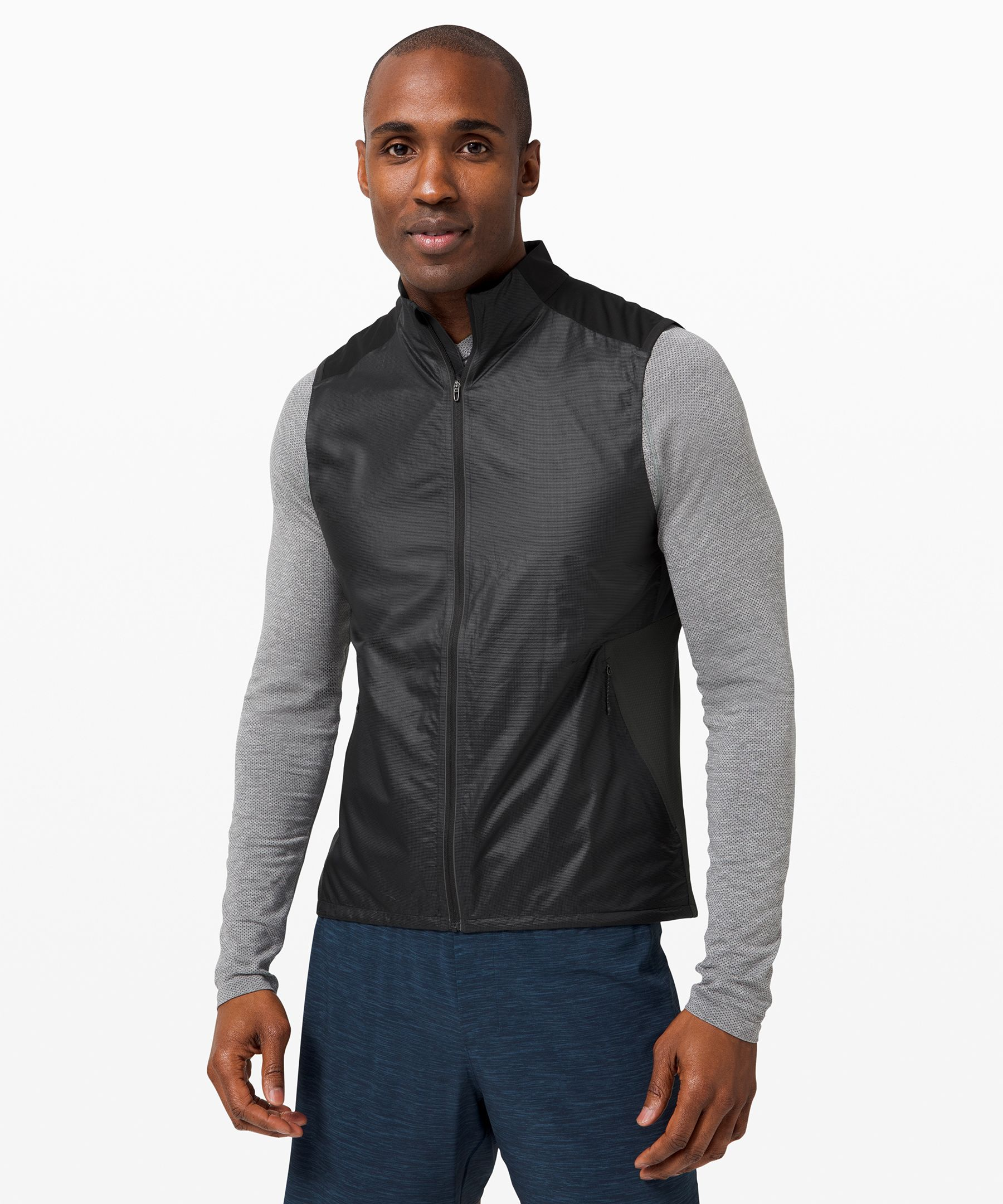Power through your last mile  with nothing holding you back.  Designed to be your optimum  running layer with a fit  that\'s made to move, this vest  is made from water-repellent  fabric on the front to protect  your core, and a Mesh fabric  back to let your body breathe.