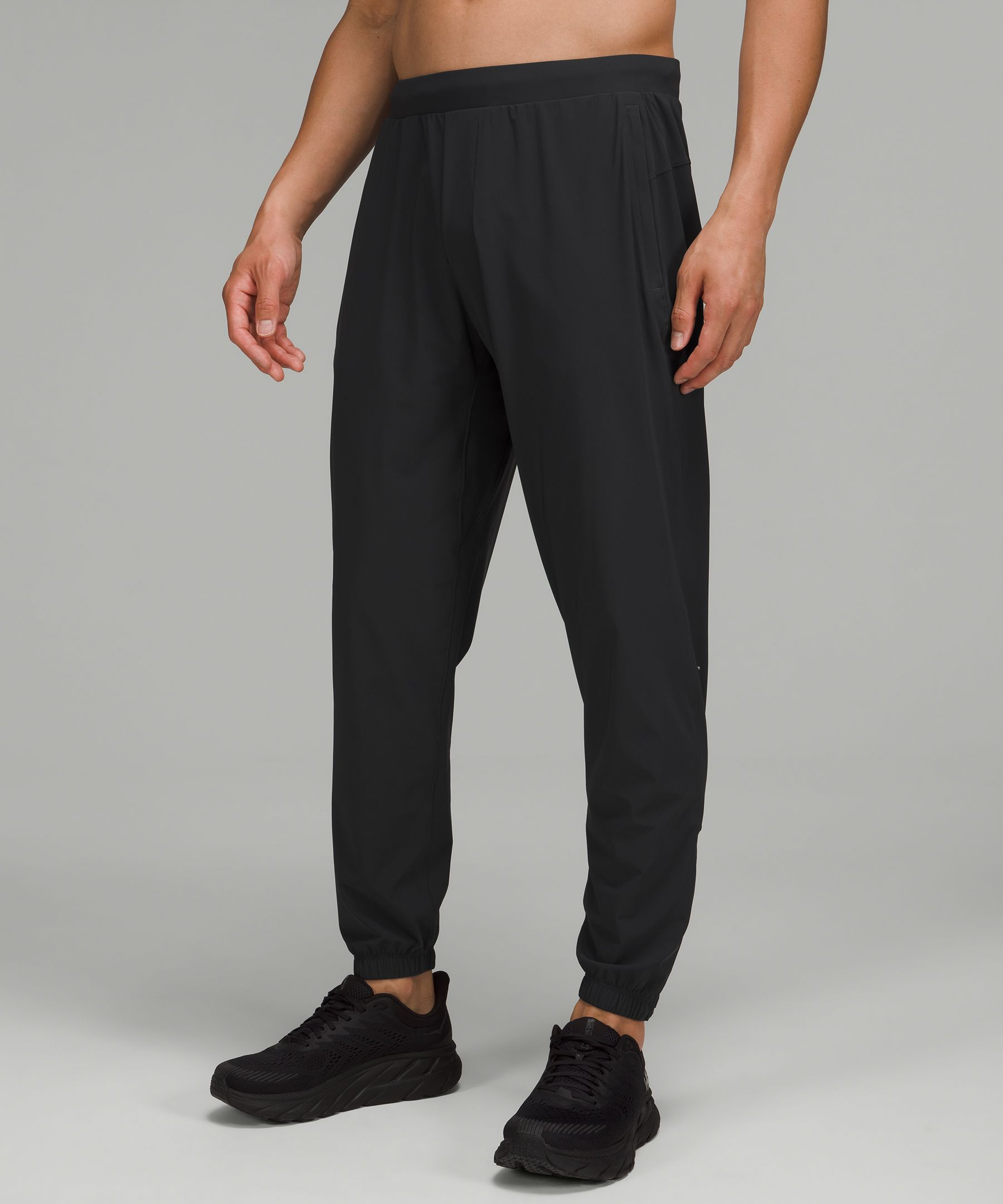 These lightweight running  joggers have zips at the cuff  for quick on and off when  you\\\'re warming up.