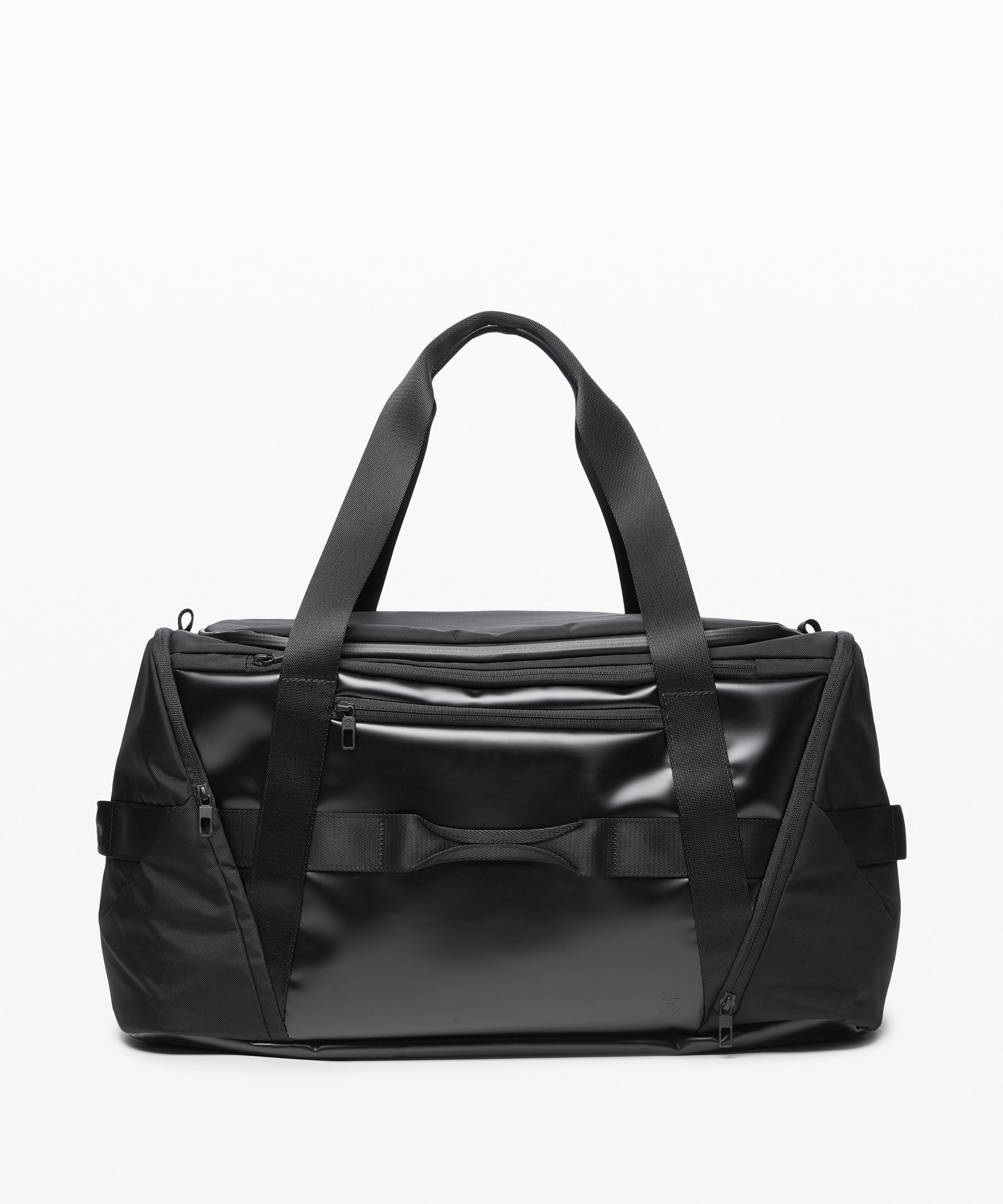 Pack for the office or the gym  with this D-zip duffel. Carry  it by the handle or attach the  straps to wear it cross-body.