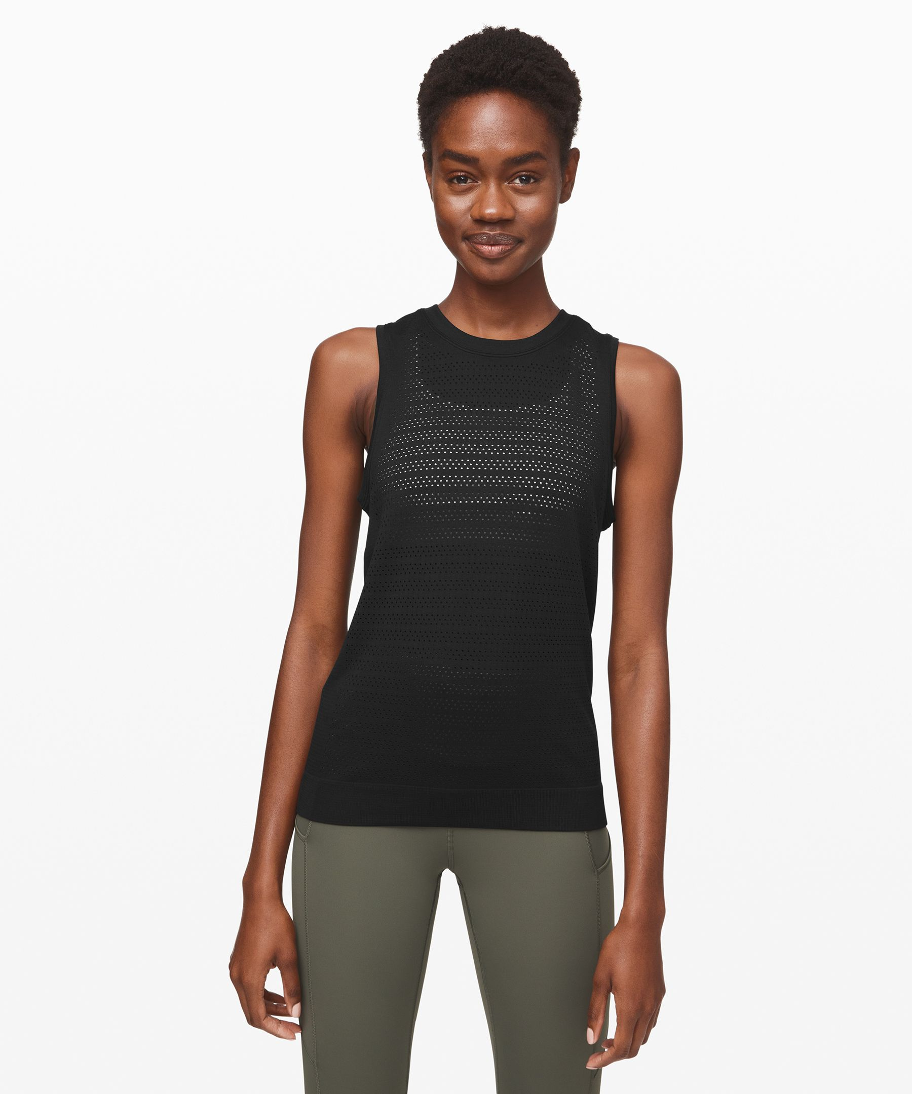 From long runs to circuit  reps, catch your cool in this  seamless, anti-stink tank.  Open-hole ventilation allows  for plenty of airflow when  your workout heats up.