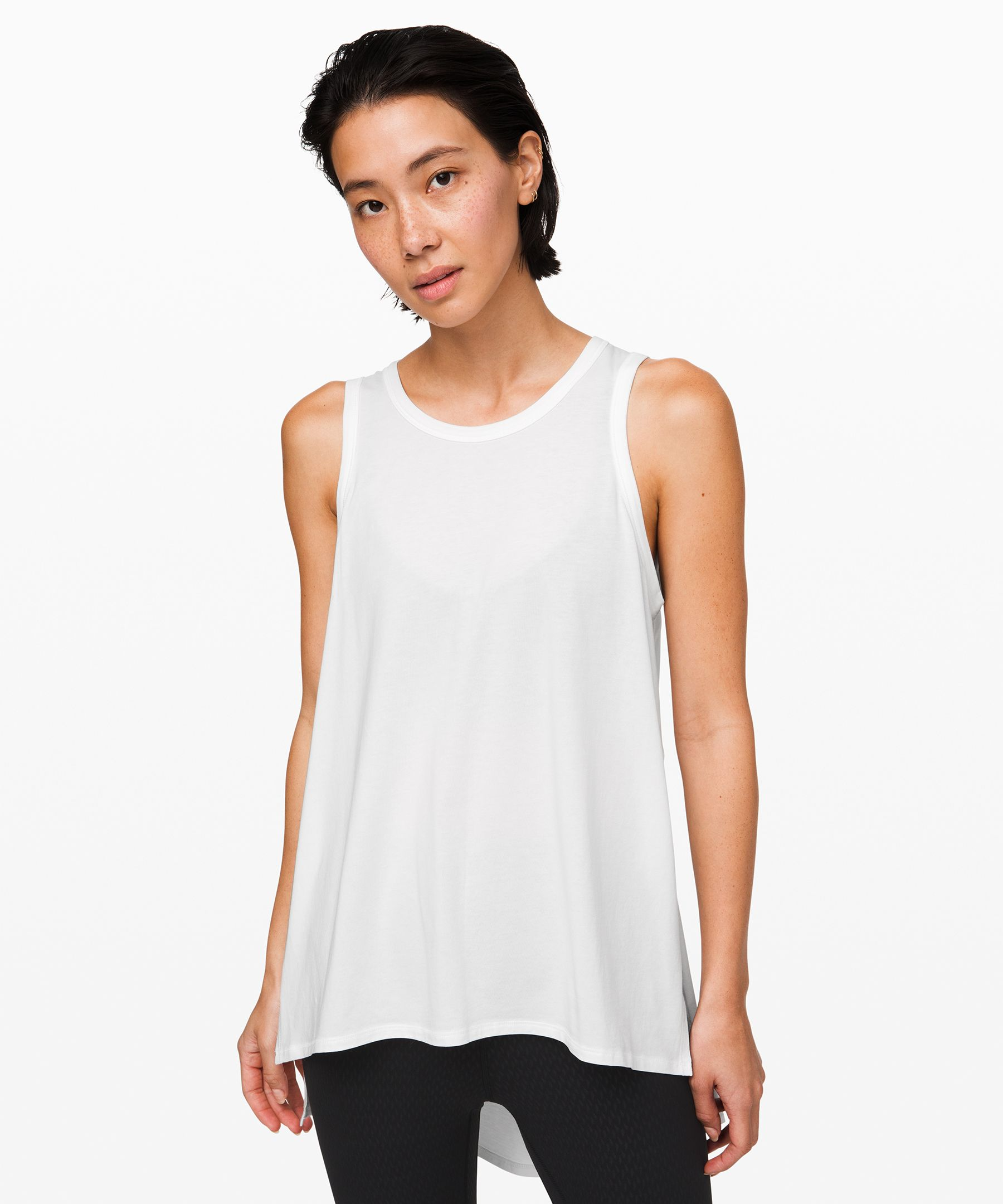 With a side slit for mobility,  this versatile tank will keep  you cool when you\'re on the  go, during your practice, and  in all the moments in between.