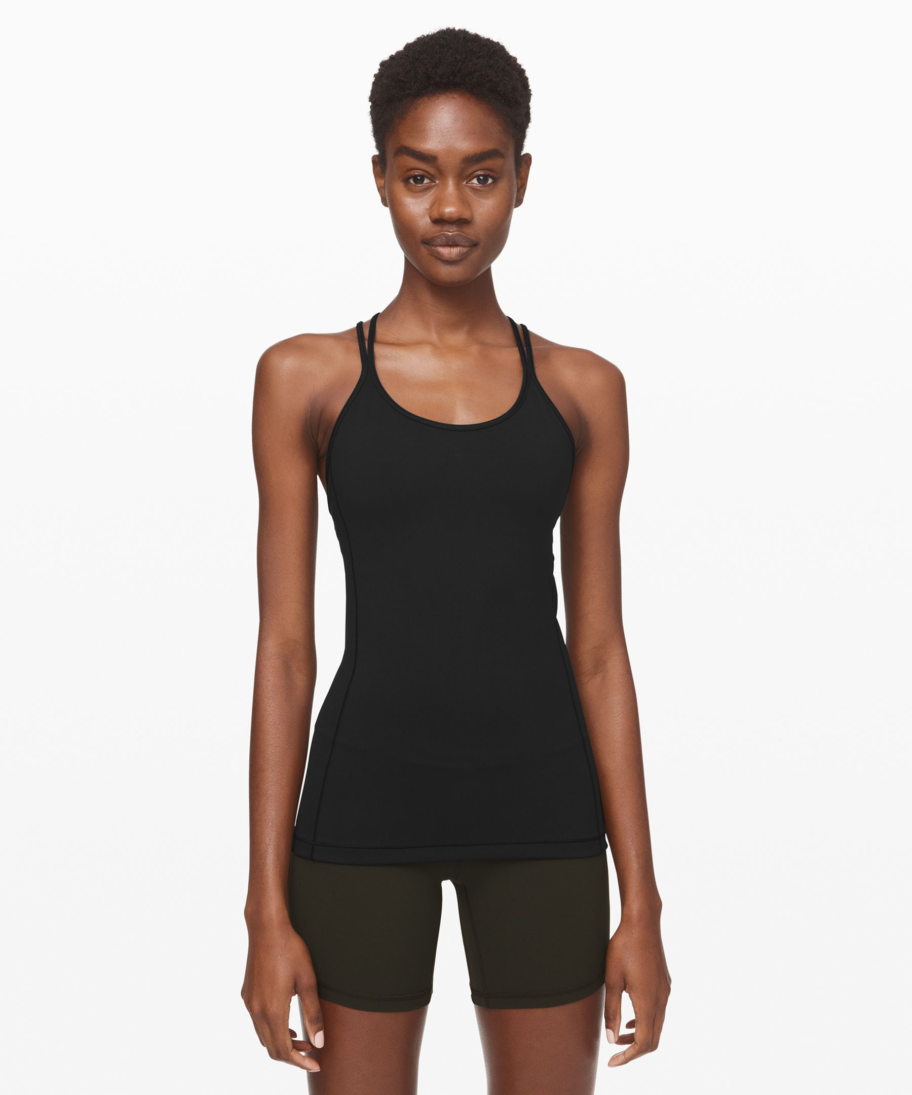 Flow freely through your yoga  practice in this lightweight,  ultra-breathable tank that  offers light support.