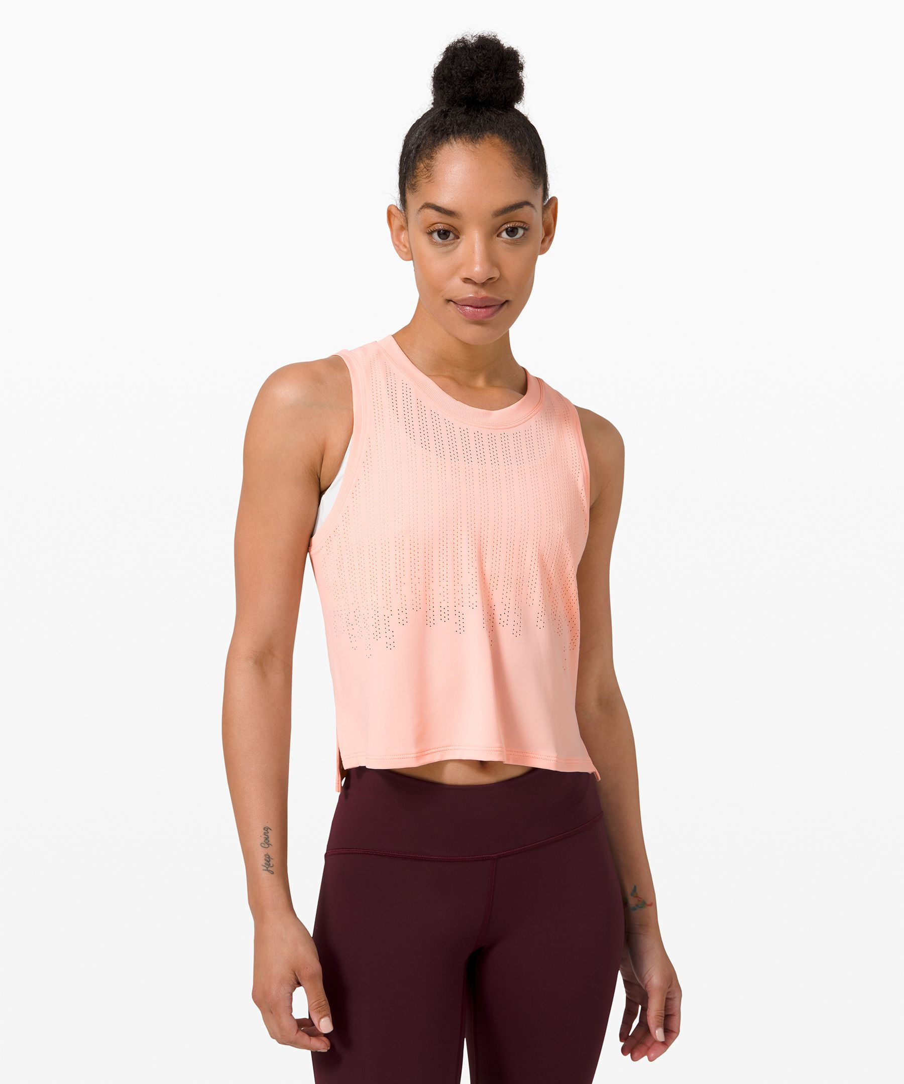 Soft, with a modern  silhouette, this tank is  perfect for restorative yoga,  intense workouts, and  everything in between.
