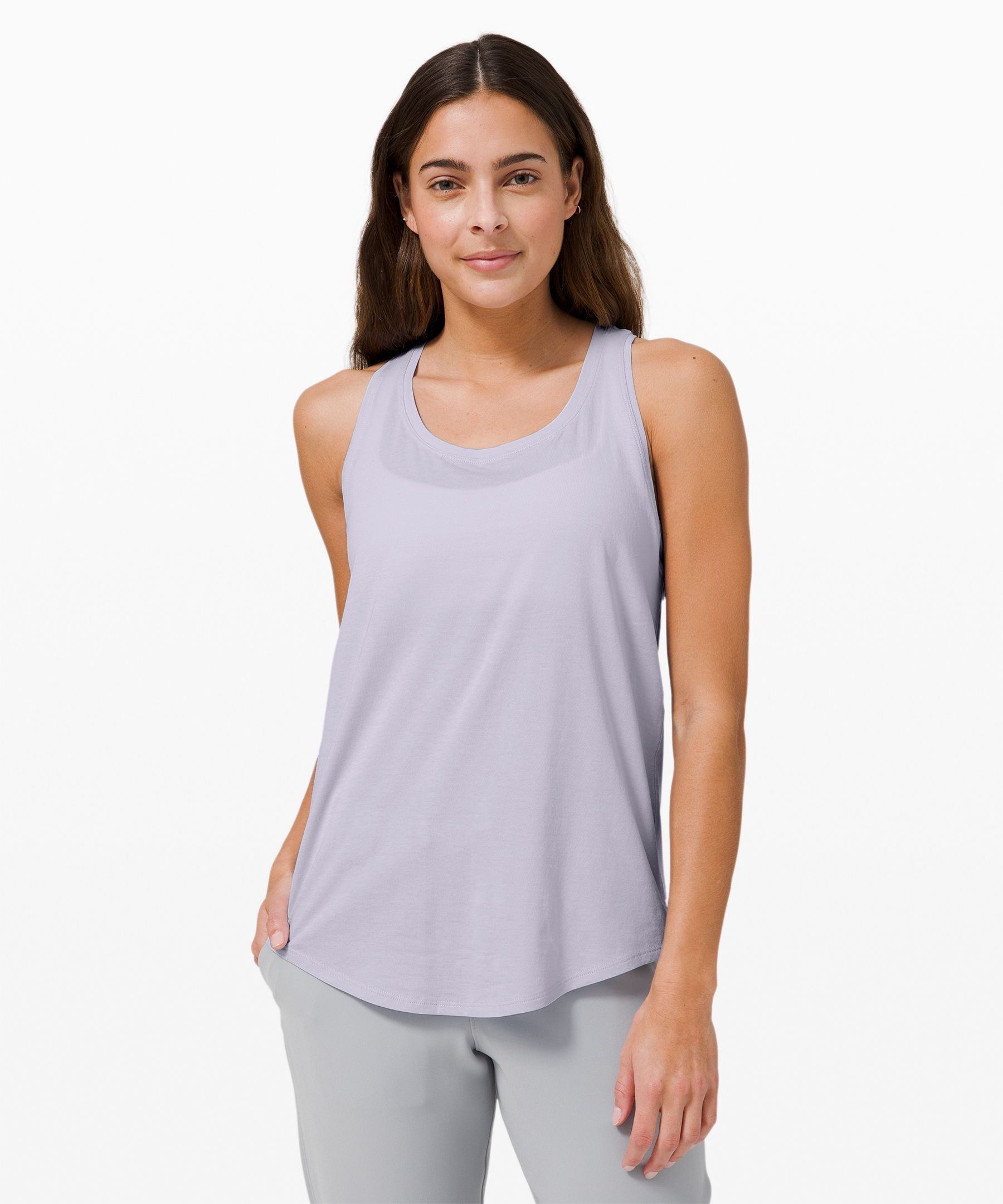 This super-soft tank won\\\'t  wear out its welcome. With  added stretch for mobility and  an easy fit to keep you cool,  it\\\'s your versatile essential,  every day.
