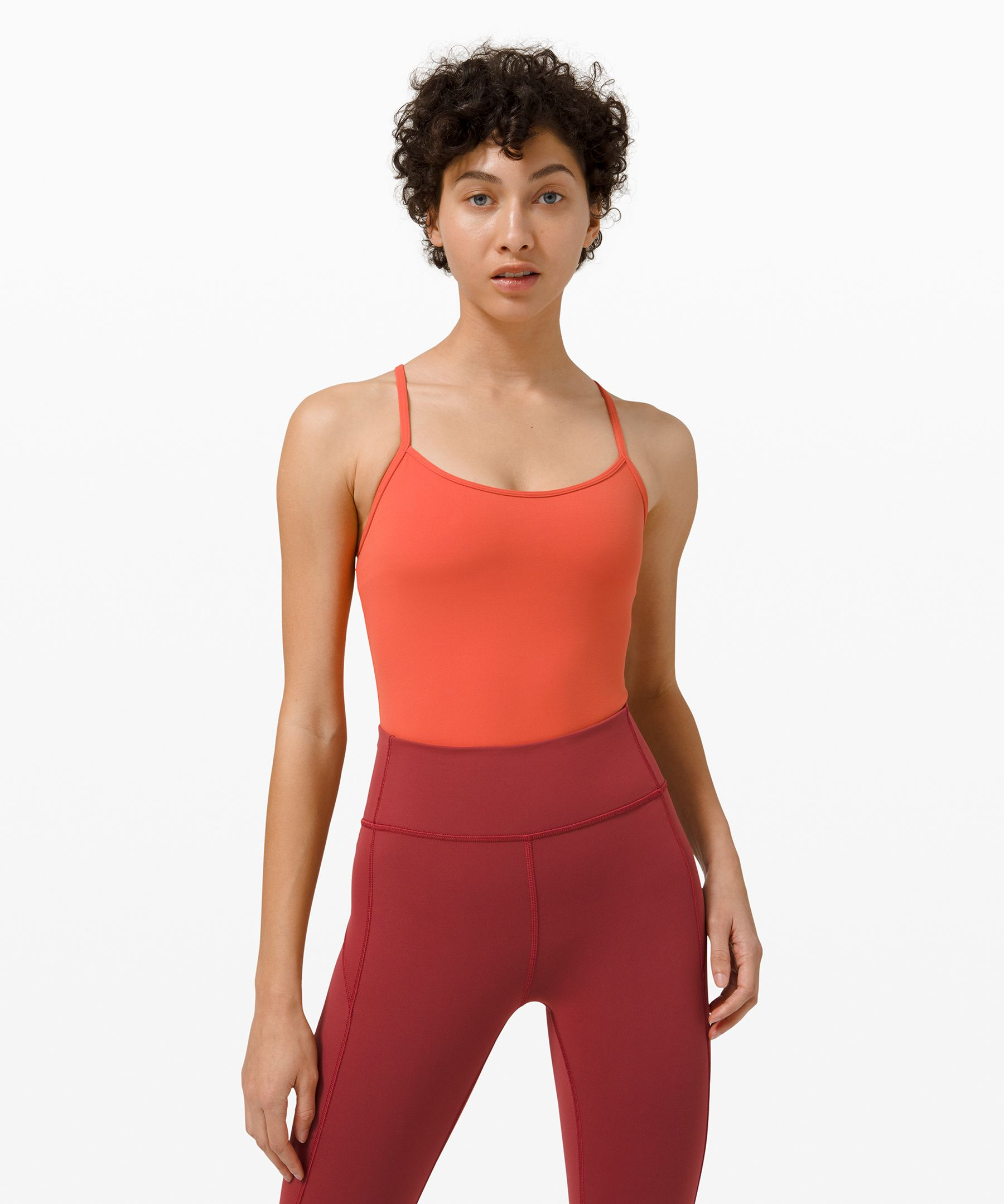 Flow freely through yoga and  studio training classes in  this skinny-strapped bodysuit  with built-in support.