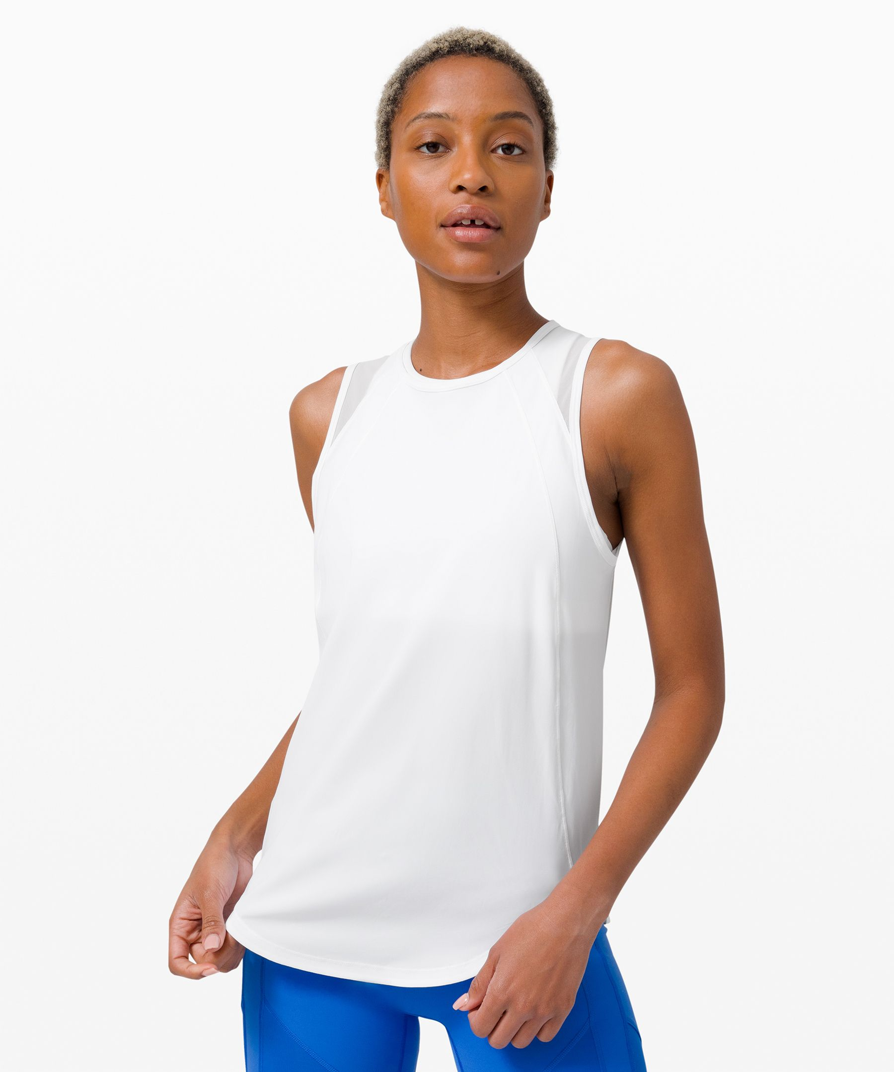 Push your limits as you sculpt  your muscles in this technical  tank, made to help keep you  cool during sweaty training  sessions. The neckline offers  coverage while the straps hide  racerback and straight-strap  bras.