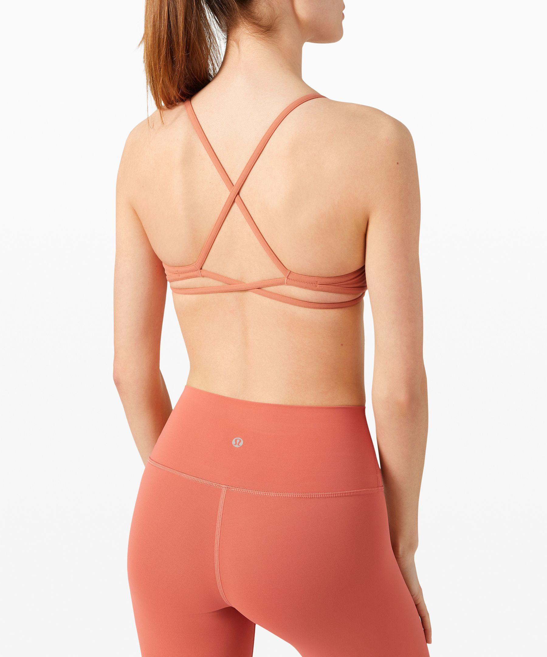 Find quiet within.  Buttery-soft performance  fabric and light cross-back  straps give your body  unrestricted movement in this  bra so your mind can relax and  restore during your practice.