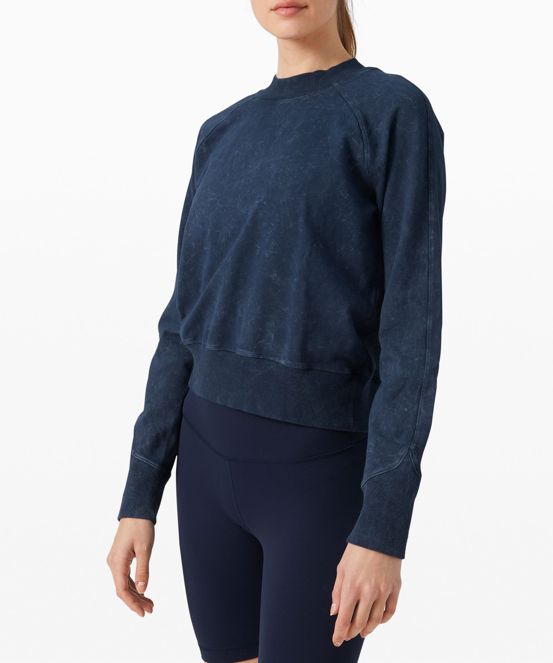 Feel cozy in this soft  crew-neck sweater that\\\'s  perfect for lightweight warmth  post practice, or to give you  some extra coverage during the  day.