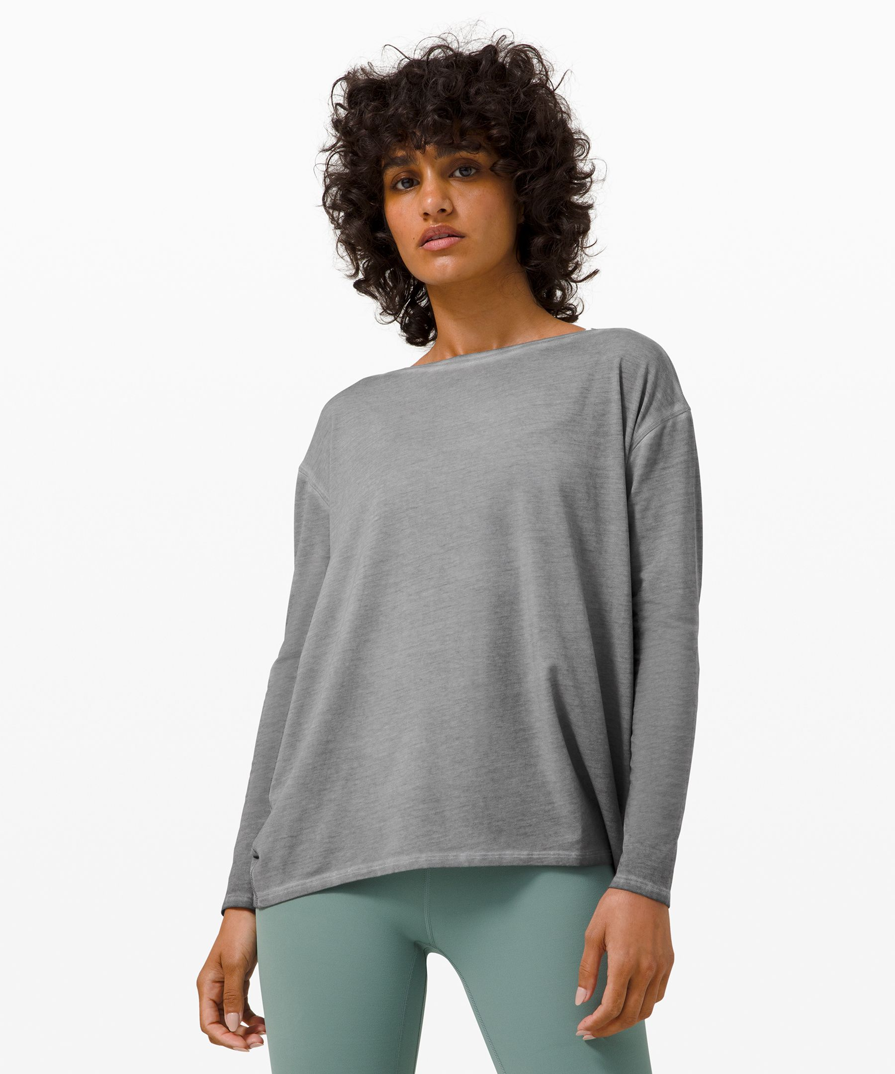 This super-soft long sleeve is  a classic you can reach for  again and again. The scooped  back hem provides extra  coverage, while added stretch  allows you to move throughout  your day with ease.