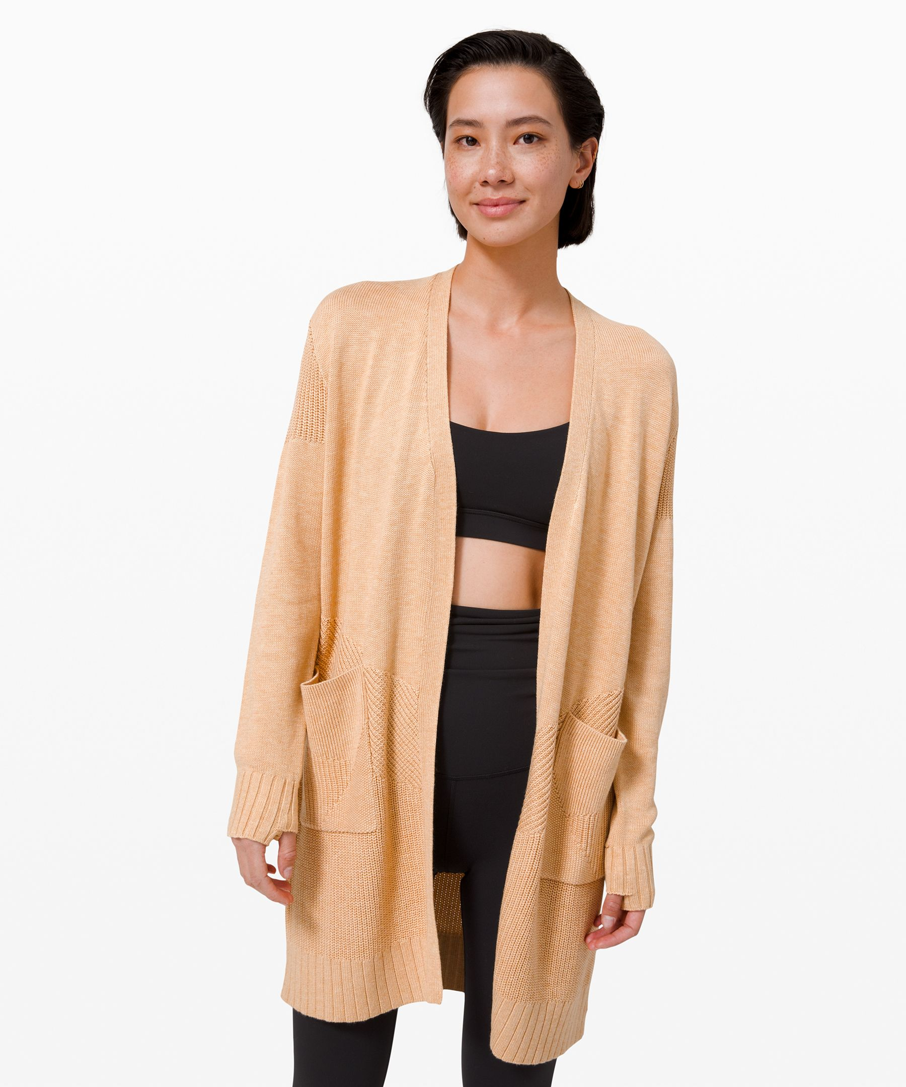 Hang on to that relaxing  post-yoga feeling of comfort  long after leaving the studio  in this long, textured wrap.