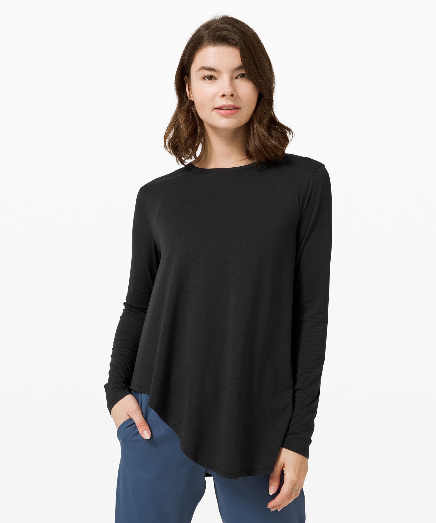 With a high neckline and a  draped hem, this long sleeve  was designed for easy layering  with ultimate comfort and  coverage in mind.