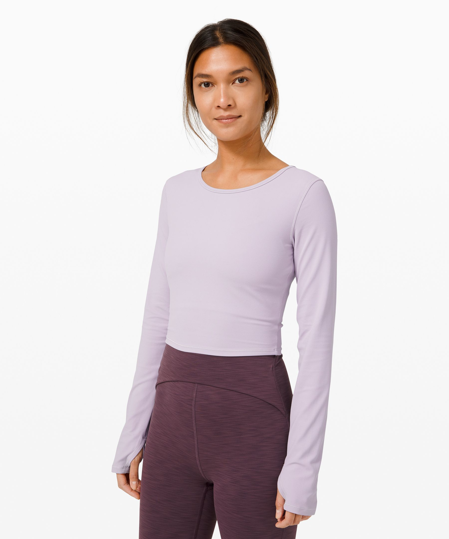 Raise the standard of your  yoga practice in this  super-soft cropped long  sleeve, designed with sweat in  mind.