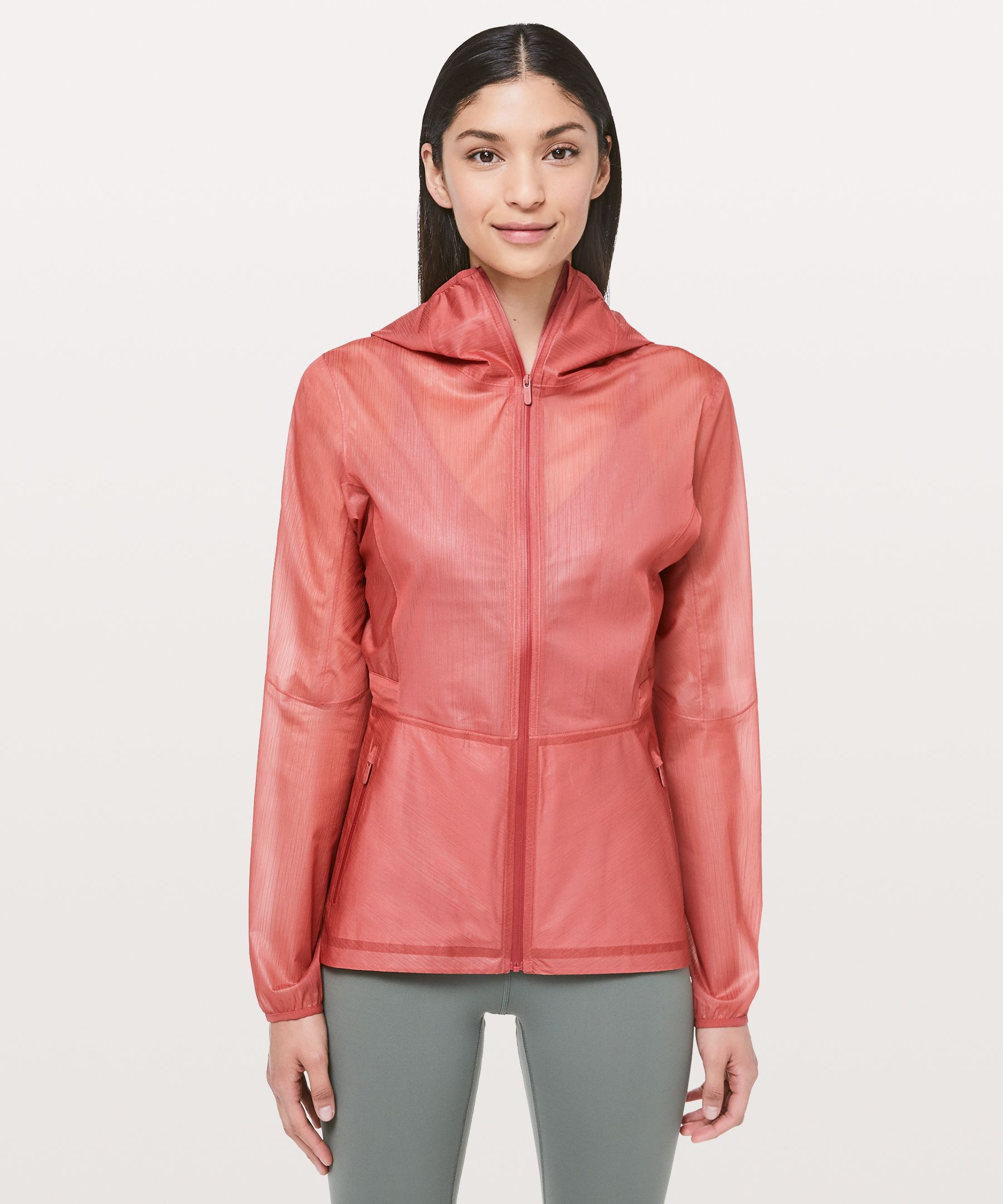 Embrace uncertain weather in  this lightweight jacket.  Translucent and textured, the  material looks like chiffon  and performs like a technical  fabric, so you can take on  light rain in style.