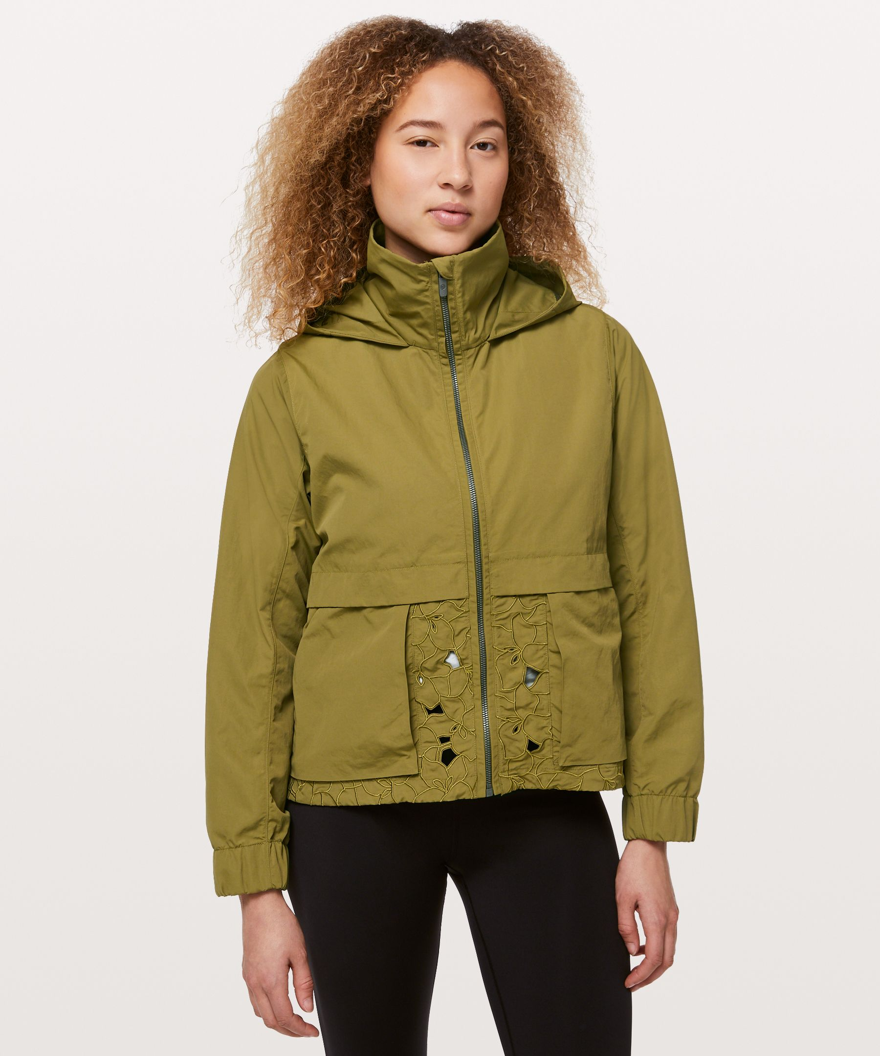 Unexpected panels of crafted  lace strike the balance  between beauty and weather  protection in this ventilated  jacket. A stowable hood and  water-repellent fabric keep it  practical, while the subtle  play of textures make an  effortless statement.