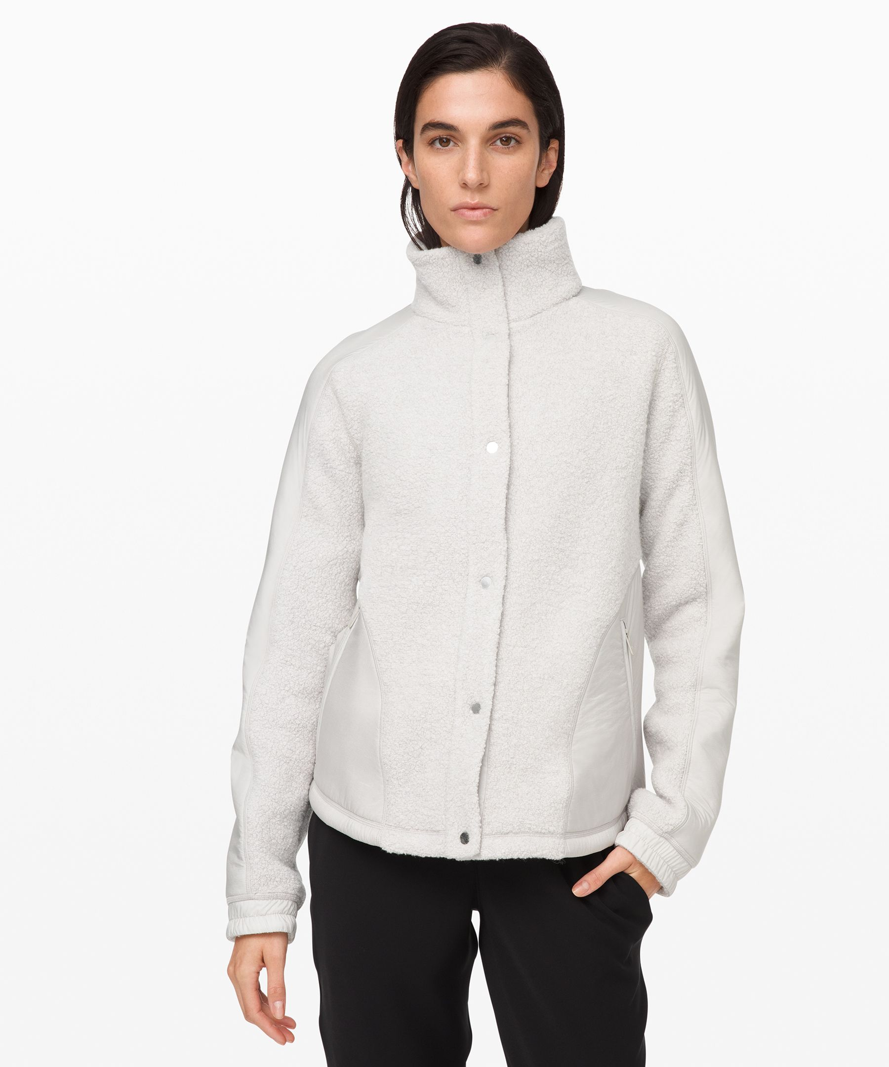 Keep the cozy going all day  long in this versatile jacket.  Cuddly Sherpa Fleece fabric  brings the warmth of natural  wool, while DWR-treated Glyde  fabric protects you from wind  and rain.
