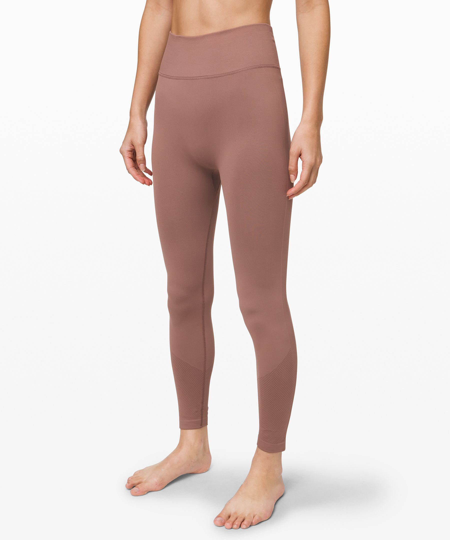 Take time to train in these  soft and simple tights.  Minimal seams and no pockets  give them a smooth fit that\\\'s  extra comfortable during floor  work.