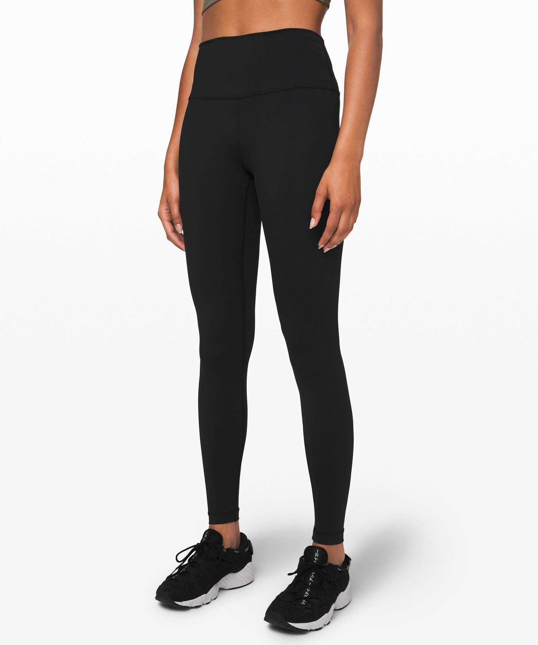 These versatile high-rise  tights were designed to fit  like a second skin—perfect for  yoga or the gym.