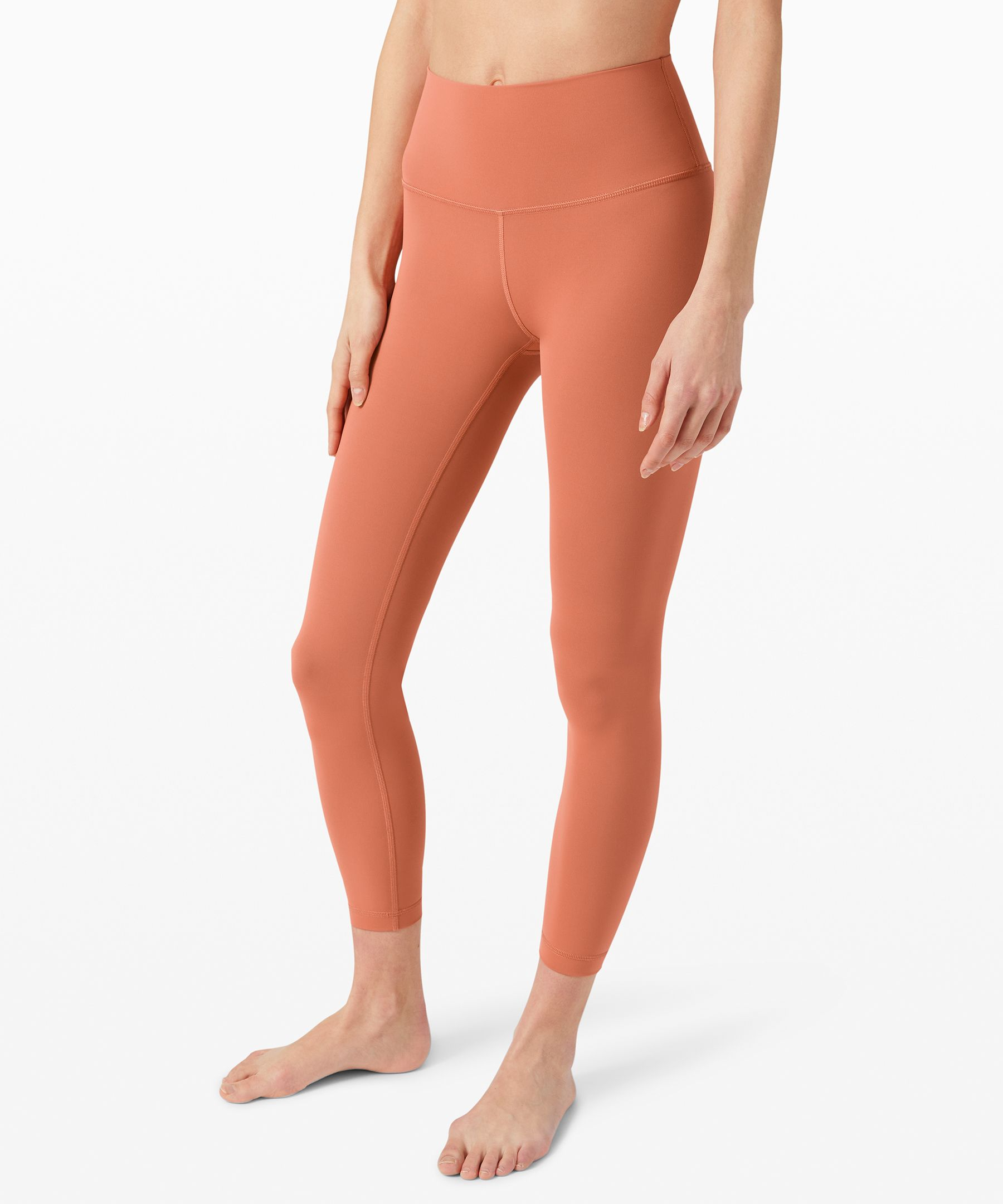 These versatile, high-rise  tights were designed to fit  like a second skin—perfect for  yoga or the gym.