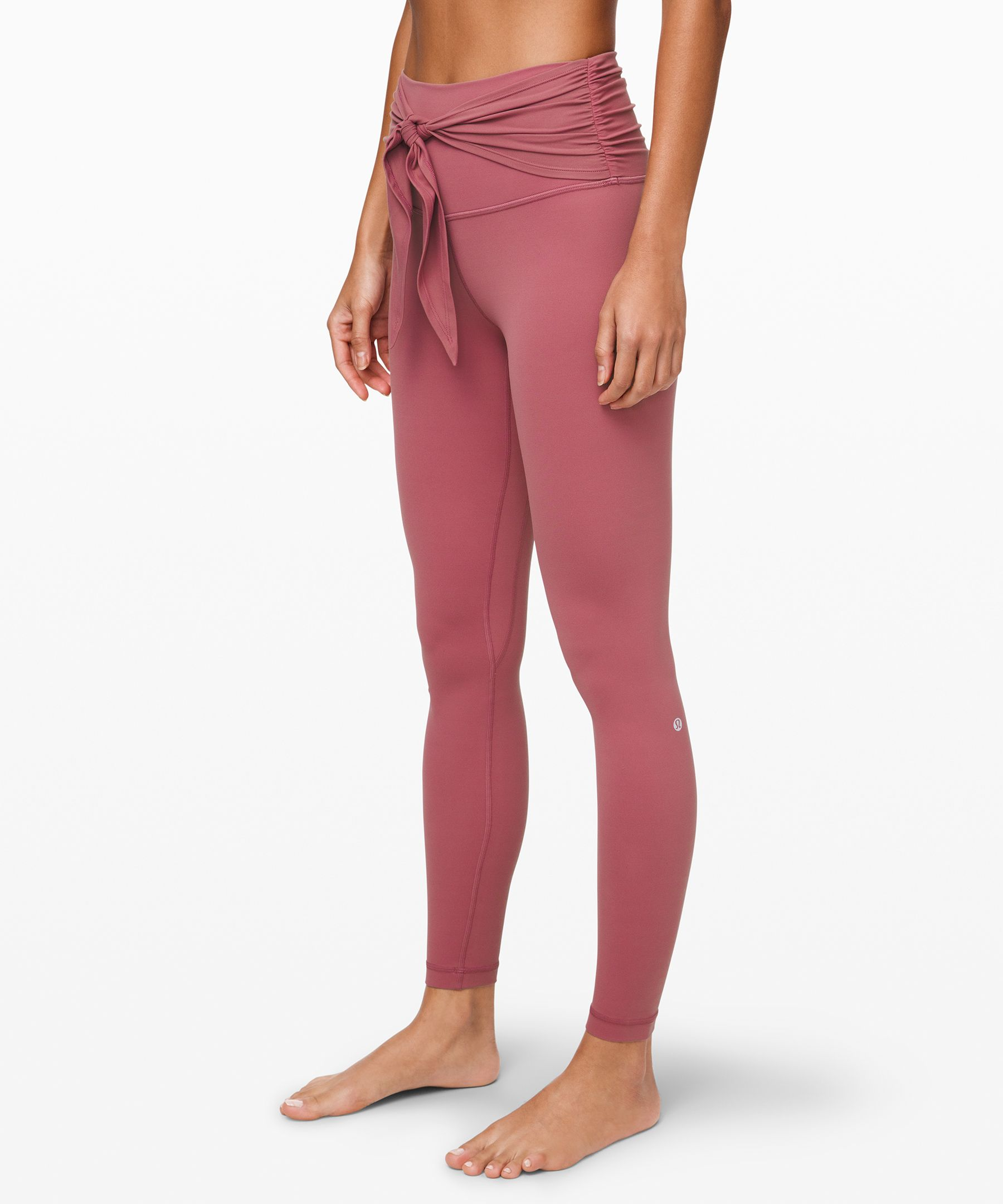 SPECIAL EDITION: Flow through  your practice distraction free  in these lightweight yoga  tights. Tie the waistband at  the front or back—or tuck the  ties inside the waistband to  keep things floorwork-friendly.