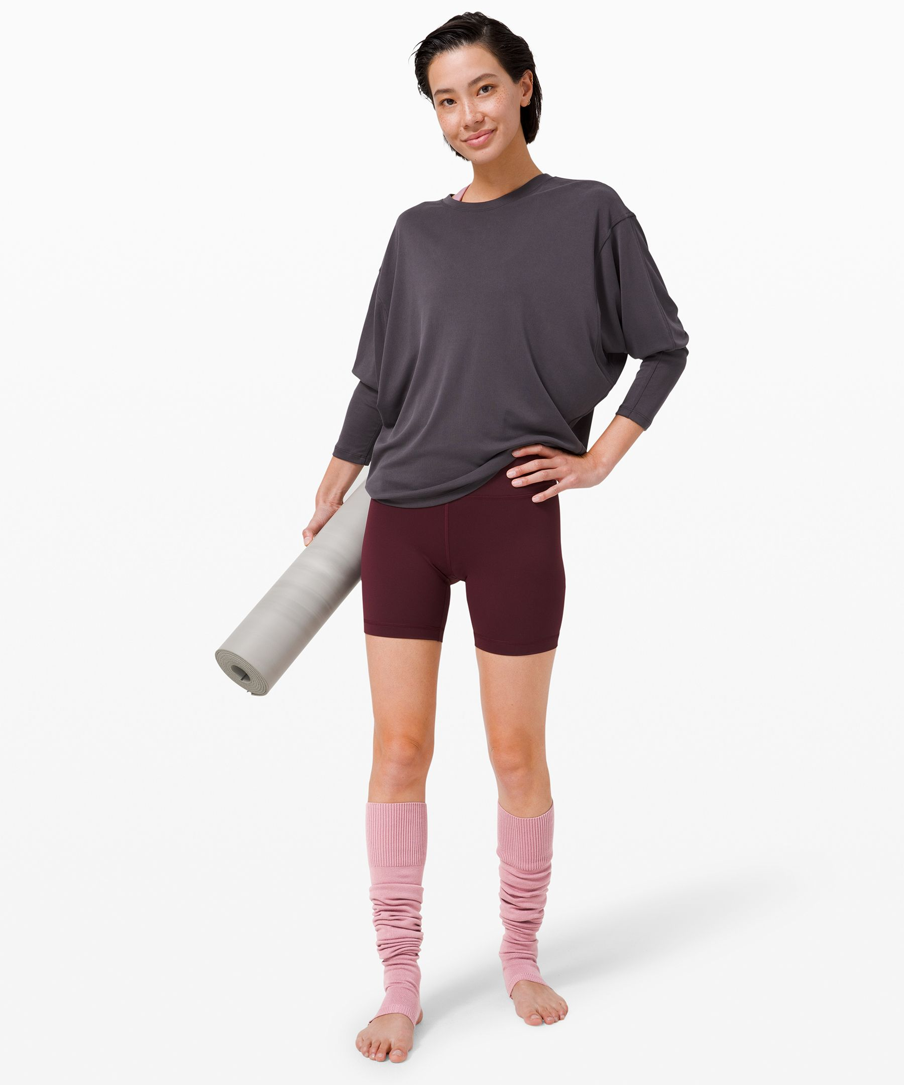 We designed these soft,  snug-fitting leg warmers to be  a perfect layer in chilly  studios. An open toe and heel  lets you grip your mat without  sliding.
