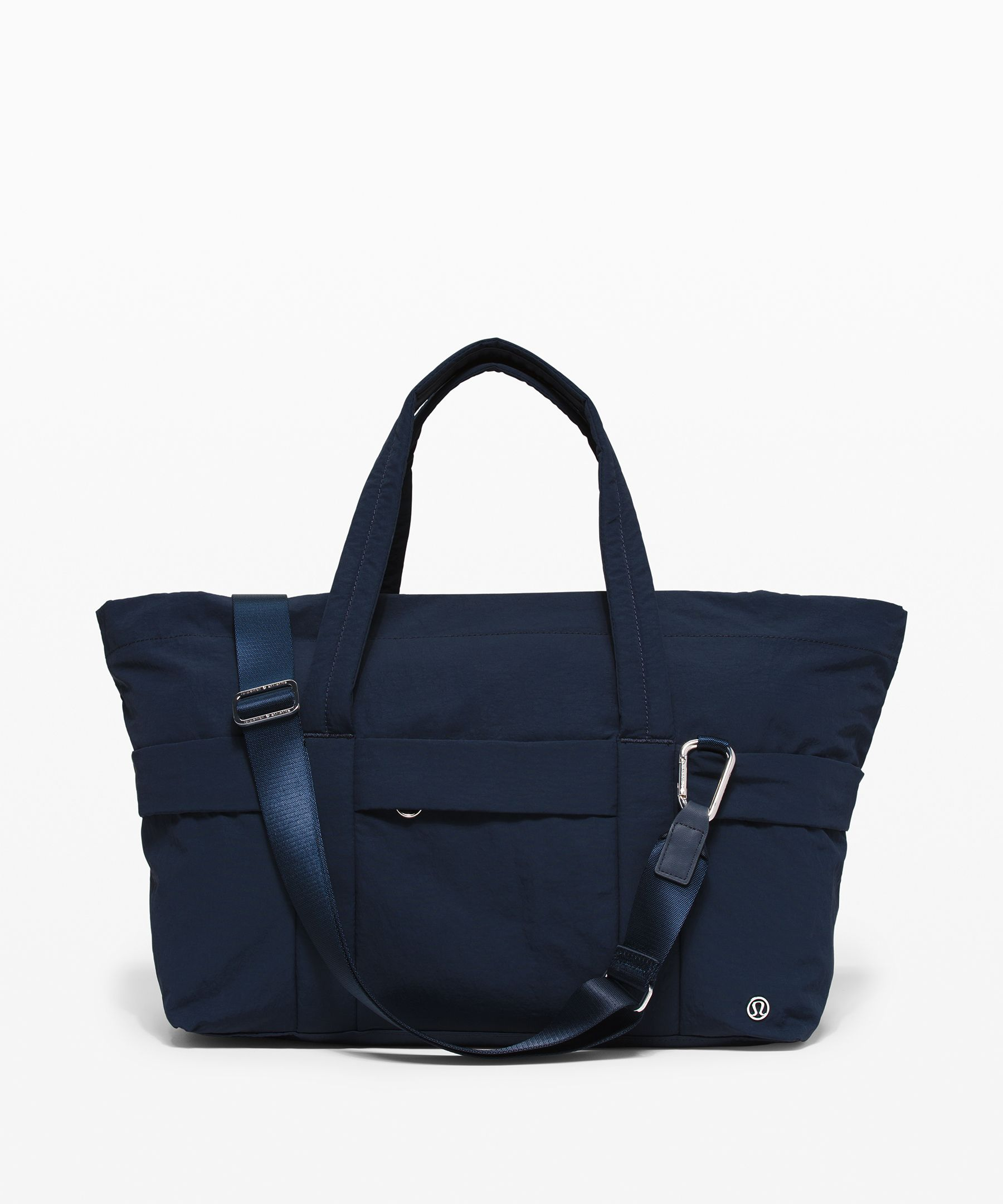Lightweight construction and  modern appeal make this roomy  duffel the perfect work to  workout companion.