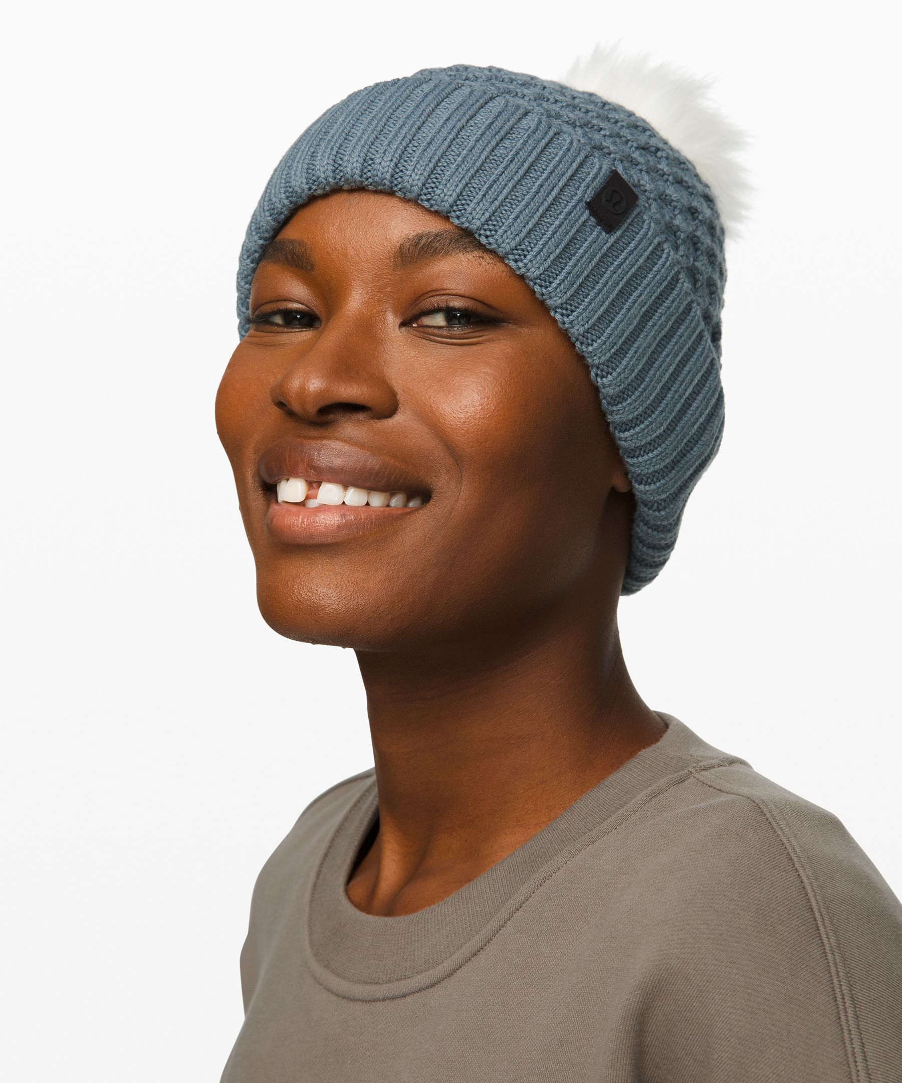 Stay warm and have fun while  you\\\'re at it in this textured  beanie. Bonus: it\\\'s topped  with a pom pom (because who  doesn\\\'t love a pom pom).