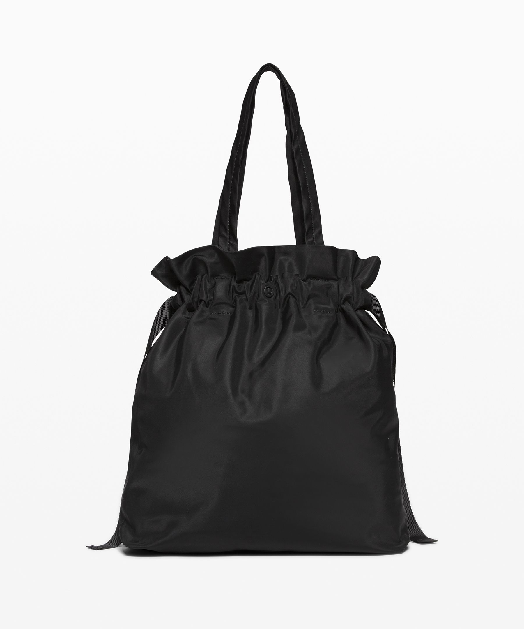 This lightweight, effortless  tote has a drawstring top so  you can dash to class with  your essentials securely in tow.