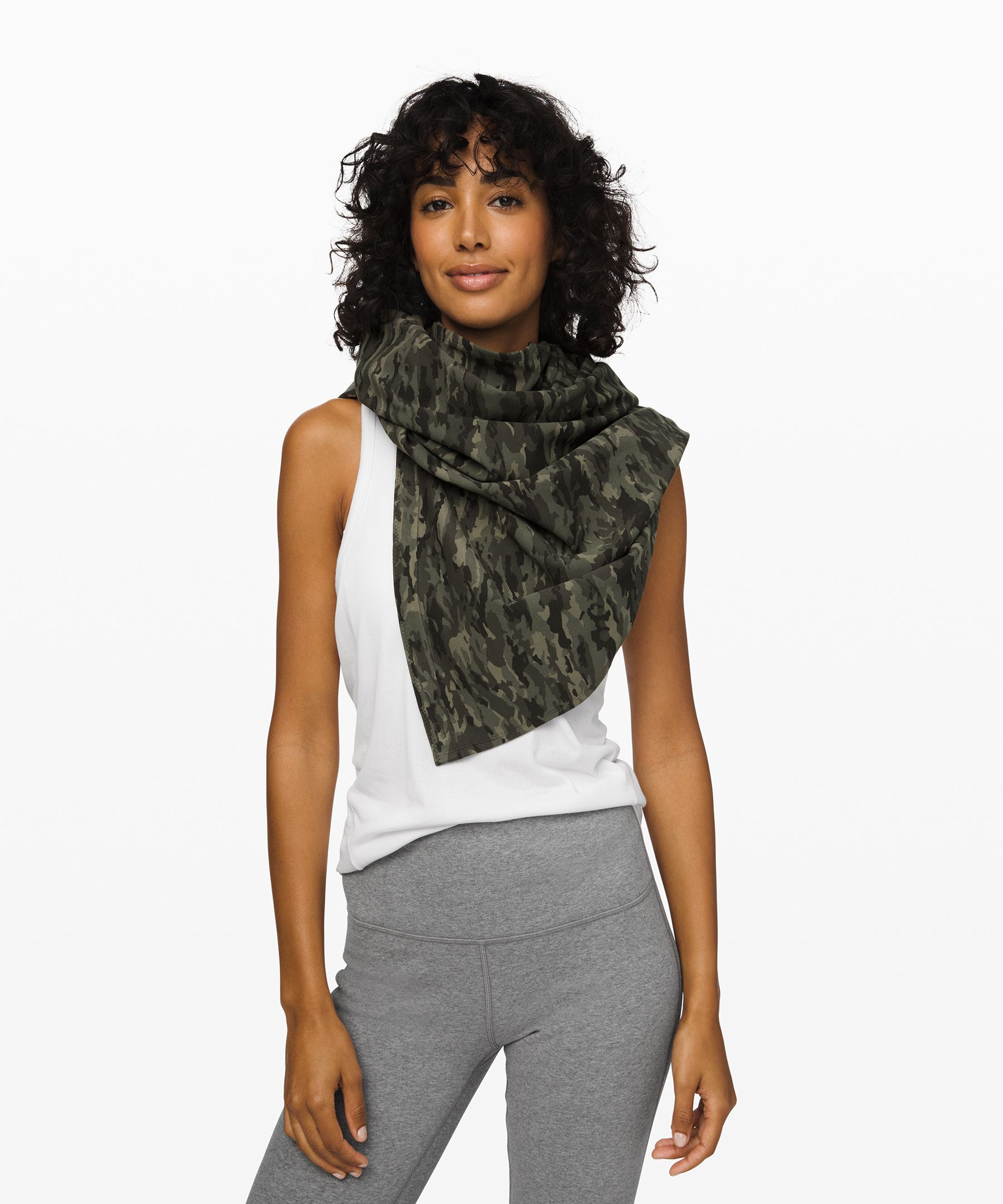 With a couple twists, this  versatile scarf turns into a  warm wrap, cozy cardigan, or  endlessly customizable  infinity scarf.