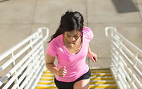 woman running up stairs - select to view mesh and liners