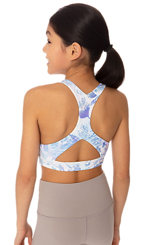 daa011082d The back of a girl wearing an active printed bra.