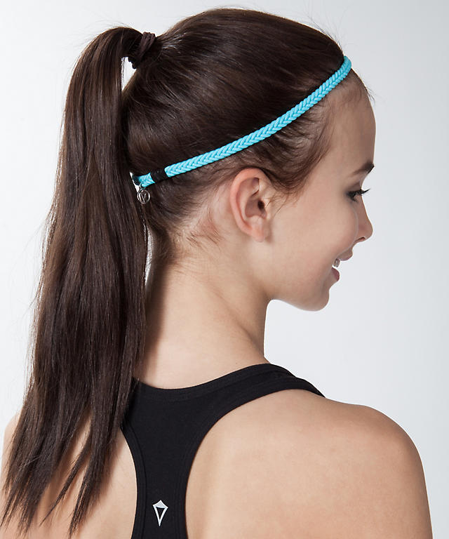 Dutch Braid Embellished Half Updo; Triple Lace Braided Rosette; Festival Hair; Braided Headband Supplies: Paddle Brush; 2 Clear elastic bands; Bobby pins; 1 1/4″ Curling Iron; Medium-hold Hairspray; Braided Headband Instructions: Step 1 / Brush through the hair to remove any tangles before parting it where you normally part it.