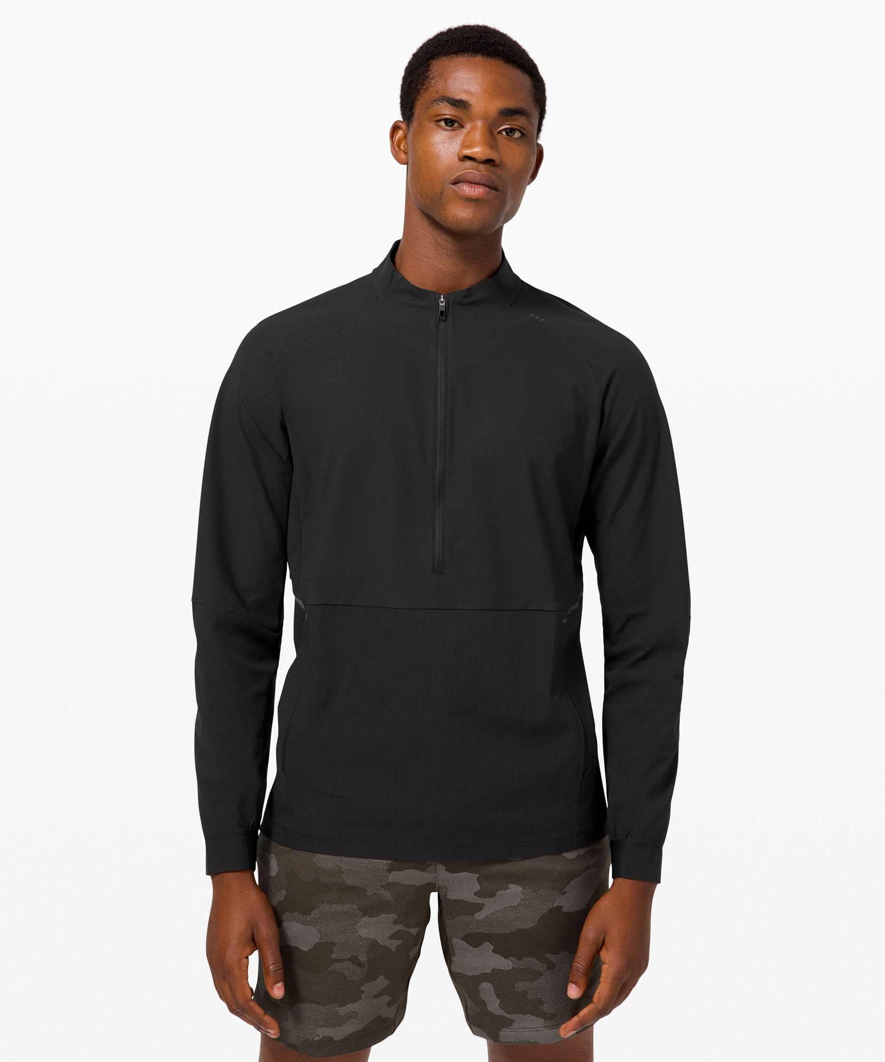 Greet the great outdoors in this water-repellent half zip. Secure pockets keep your essentials accessible on the trail or the court.