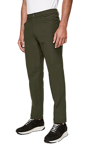 466c41d9a 1/3 view of men's lower body wearing dark olive classic fit pants.
