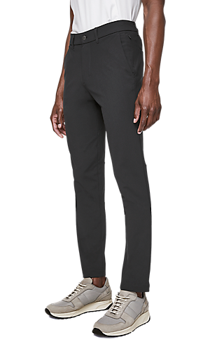 2186e532ca8 1/3 view of men's lower body wearing slim grey pants.