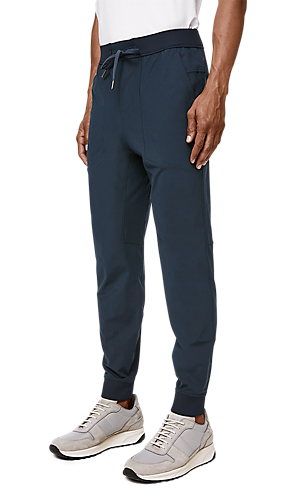 4fbac3efb29cdc 1/3 view of men's lower body wearing jogger pants.