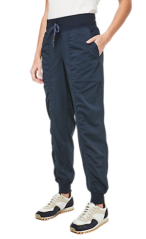 1477329e2f74 1 3 view of women s lower body wearing blue jogger pants.