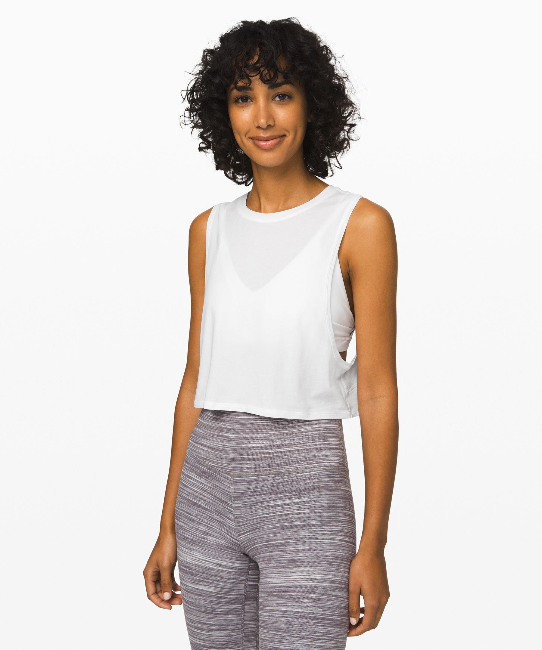 We designed this cropped tank  with low armholes to help keep  you cool to and through your  practice.