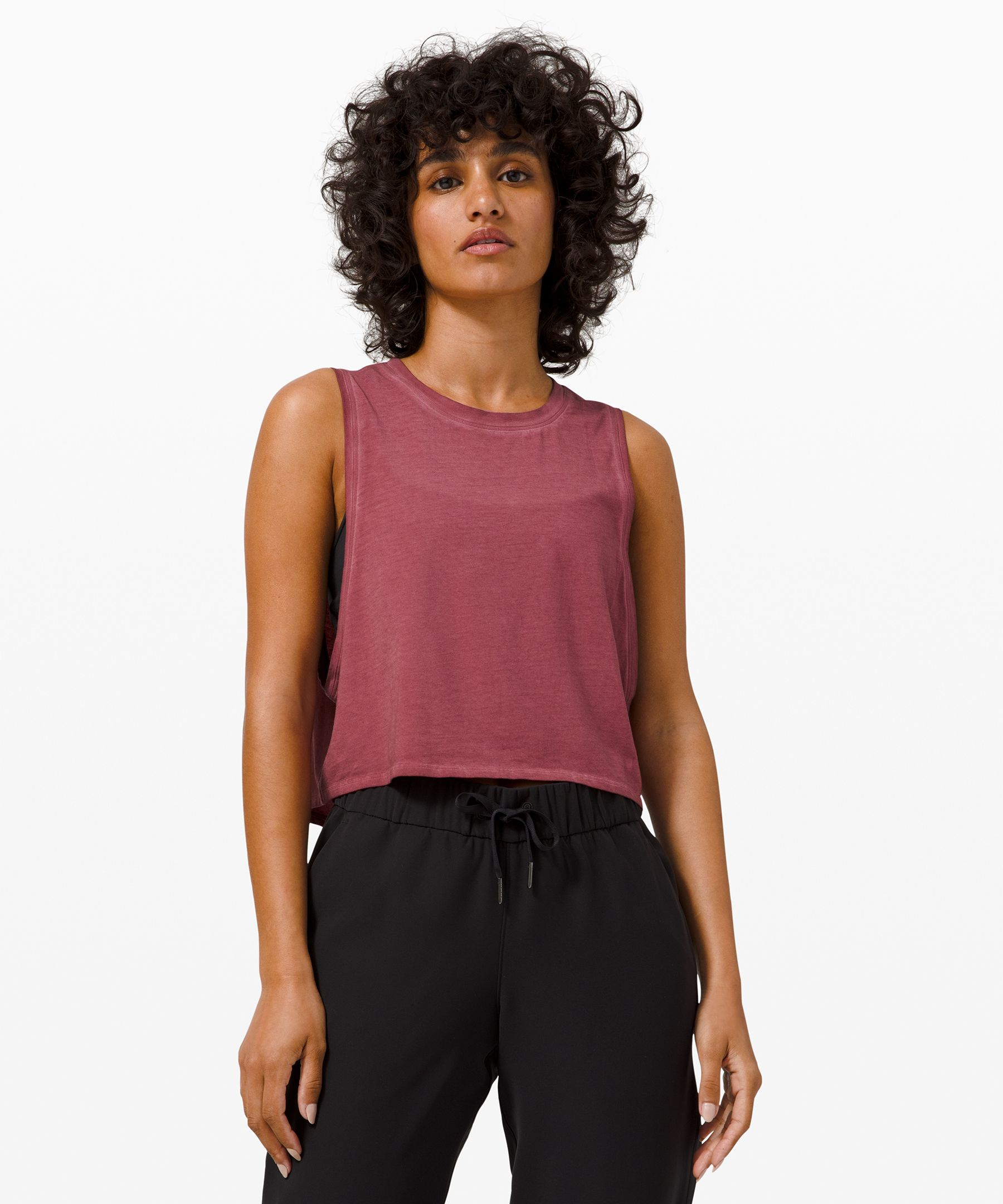 Stay cool on warm days in this  soft, breathable Pima Cotton  tank that features low  armholes and a back keyhole  for extra airflow.
