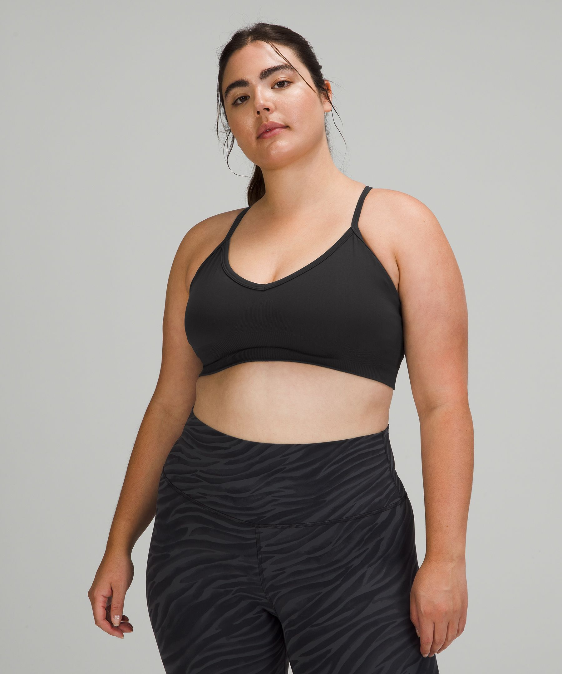 Reach your full expression of every pose. Soft fabric moves with you as you bend and twist in this convertible-strap bra.