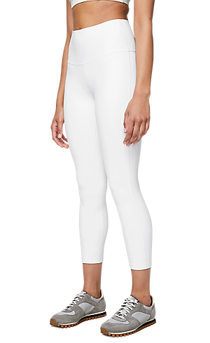 9838958643ba 1/3 view of women's lower body wearing white tight pants.