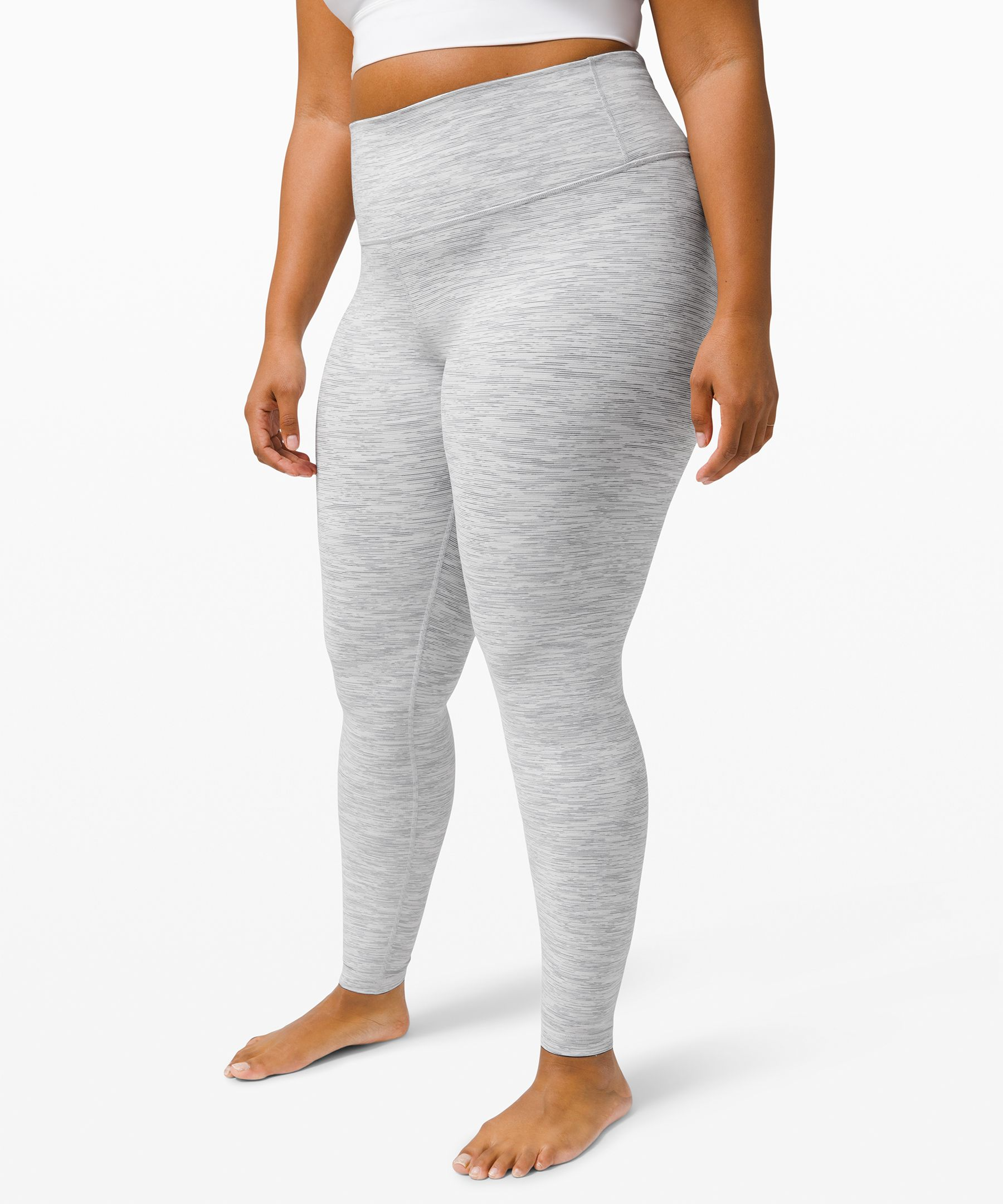 Train, flow, and chill in the  versatile Wunder Under  collection. Minimal seaming, a  wide waistband, and  performance fabric make these  tights a sweaty staple.