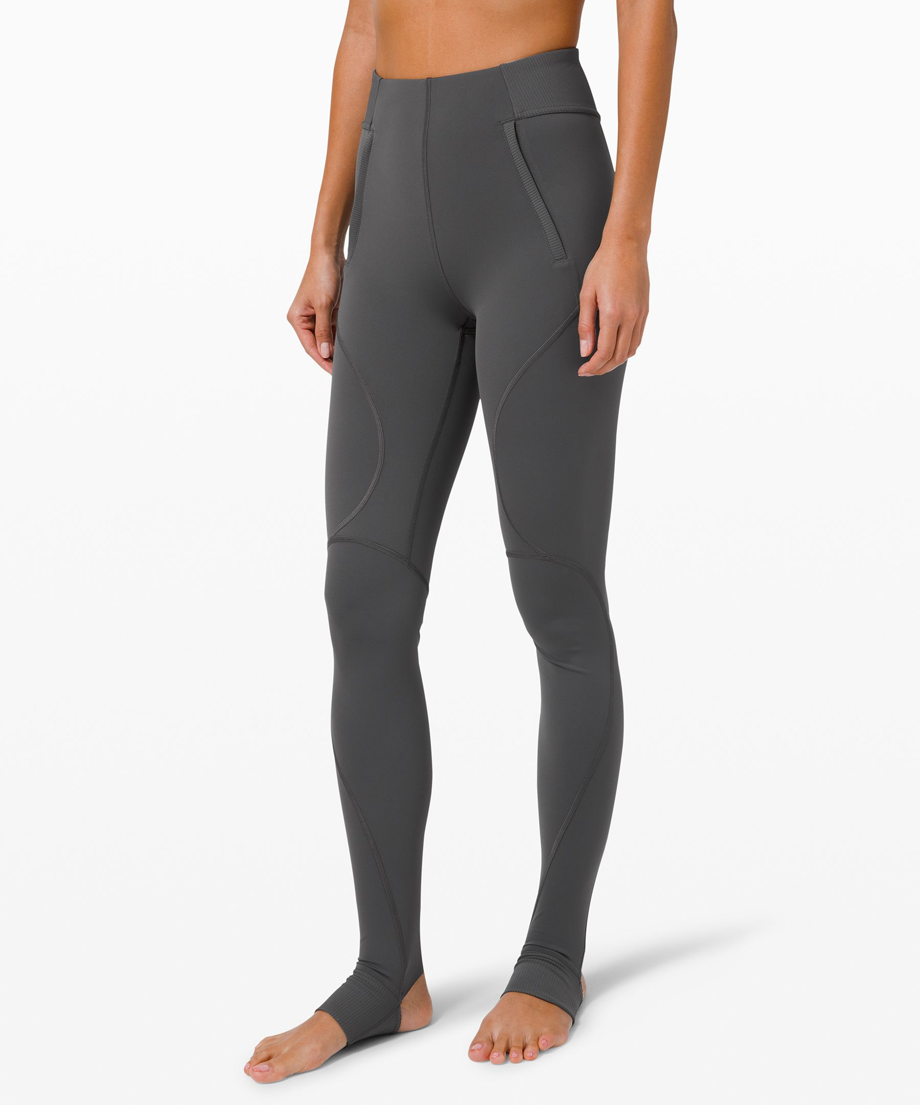 Move freely and forget your  sweat in these sleek,  technical tights. Roll up the  ribbed stirrups after your  workout for a cuffed look as  you transition from studio to  street.